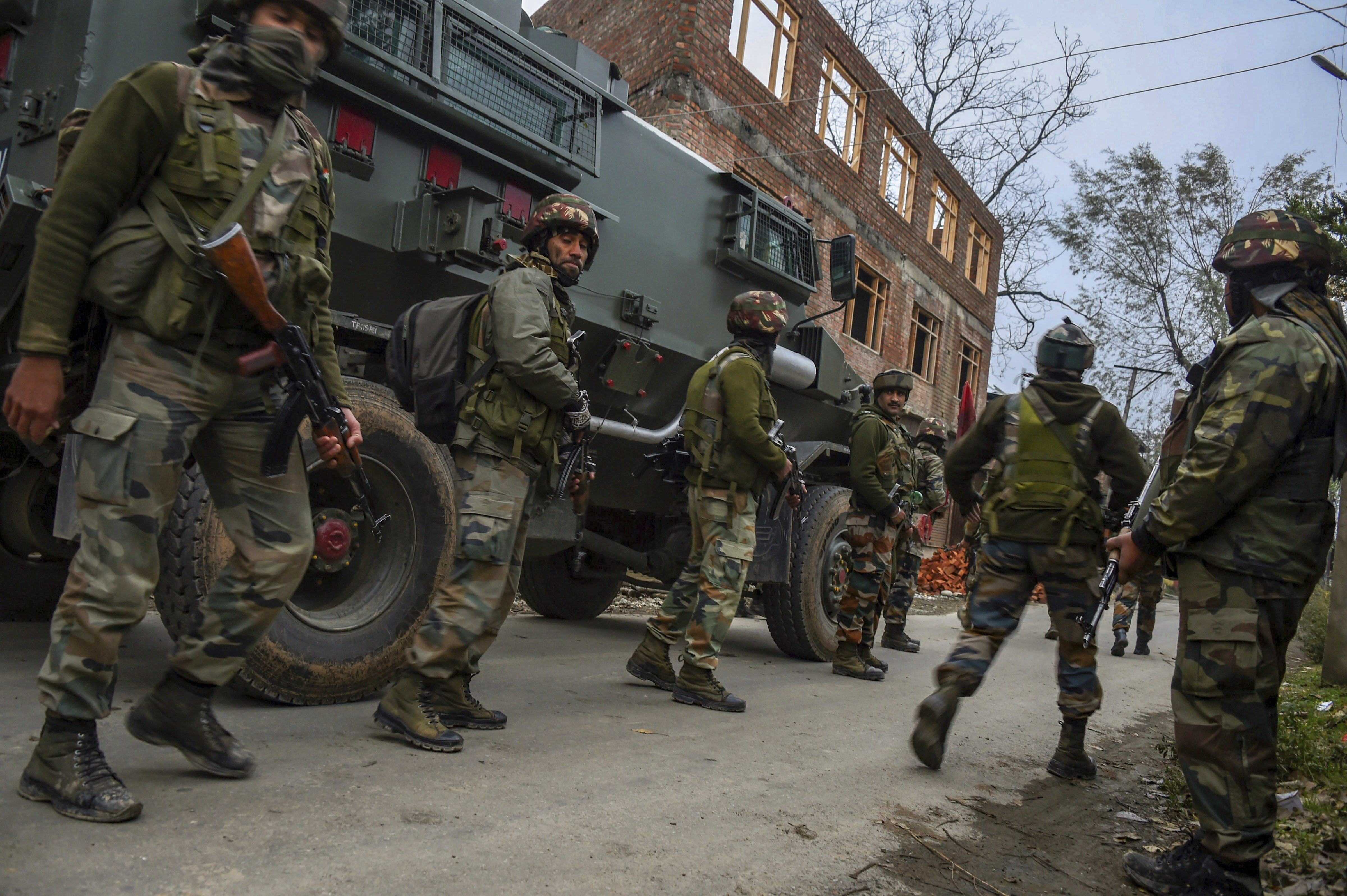 Army soldiers during cordon and search operation at Bakoora on the outskirts of Srinagar - PTI