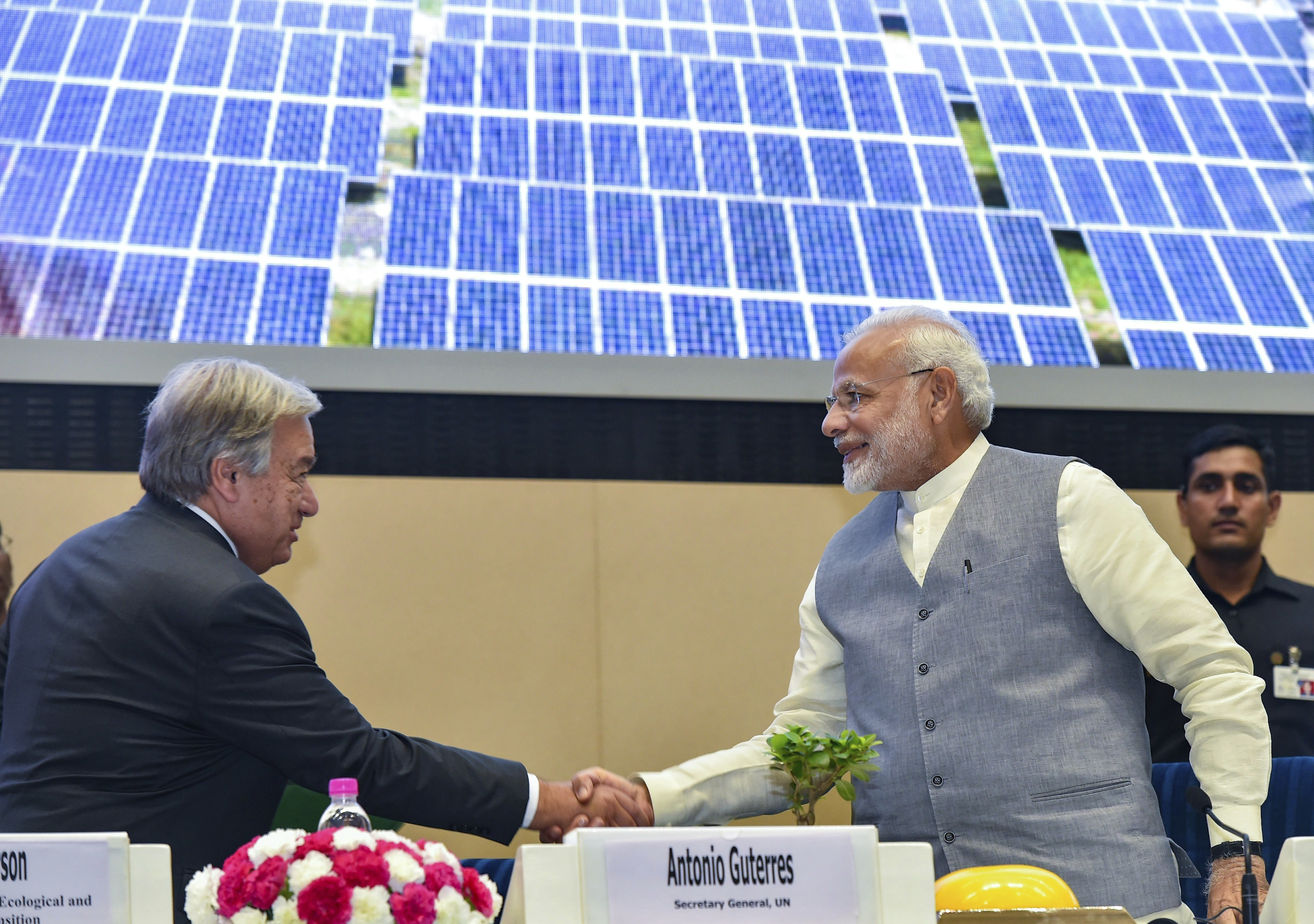 Prime Minister Narendra Modi and United Nations Secretary-General Antonio Guterres shake hands at the inauguration of 1st Assembly of International Alliance (ISA), 2nd IORA Renewable Energy Ministerial Meet & 2nd Global RE-Invest 2018, at Vigyan Bhavan in New Delhi - PTI