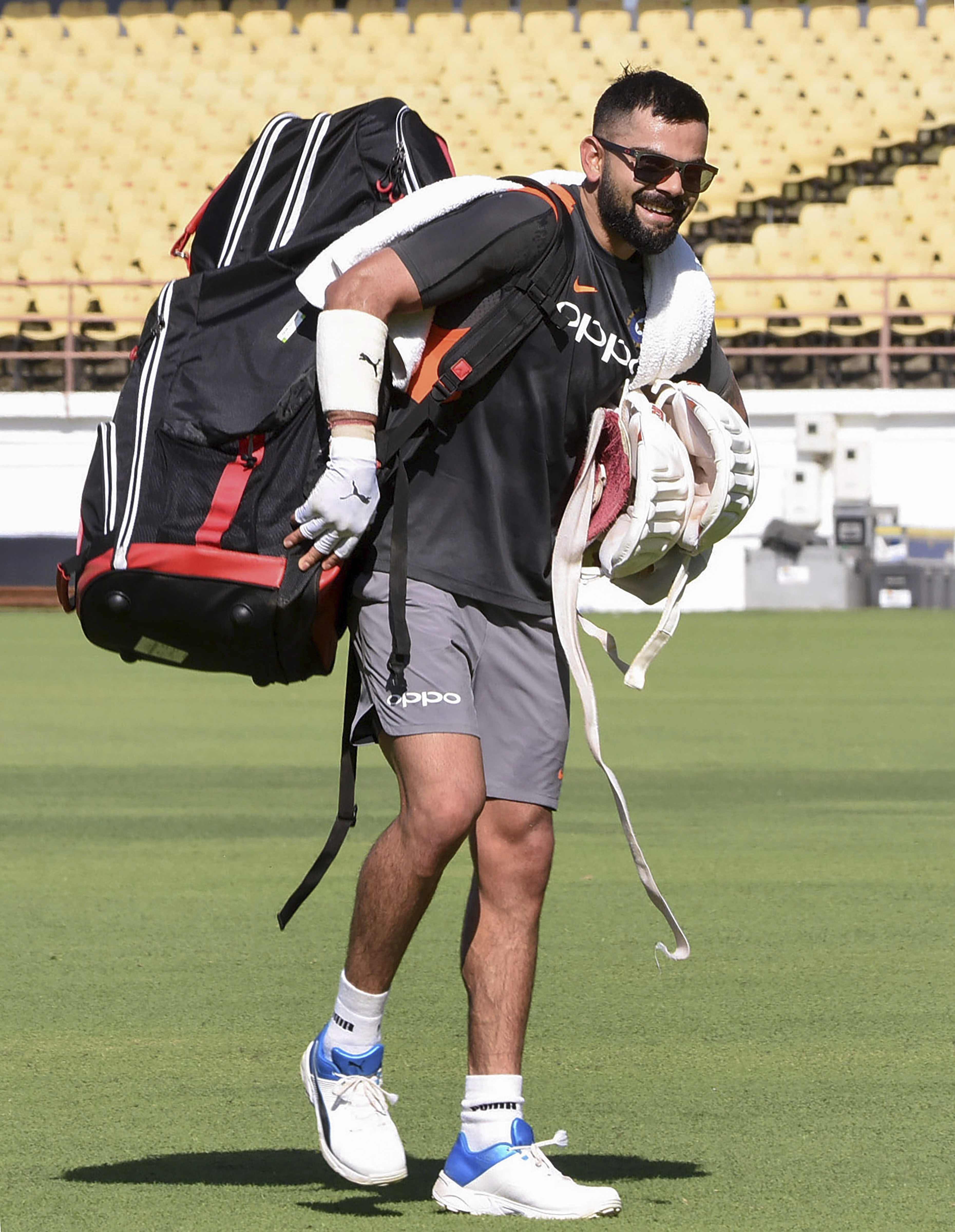 Indian cricket captain Virat kohli during a practice session ahead of the first test match against West Indies, in Rajkot - PTI