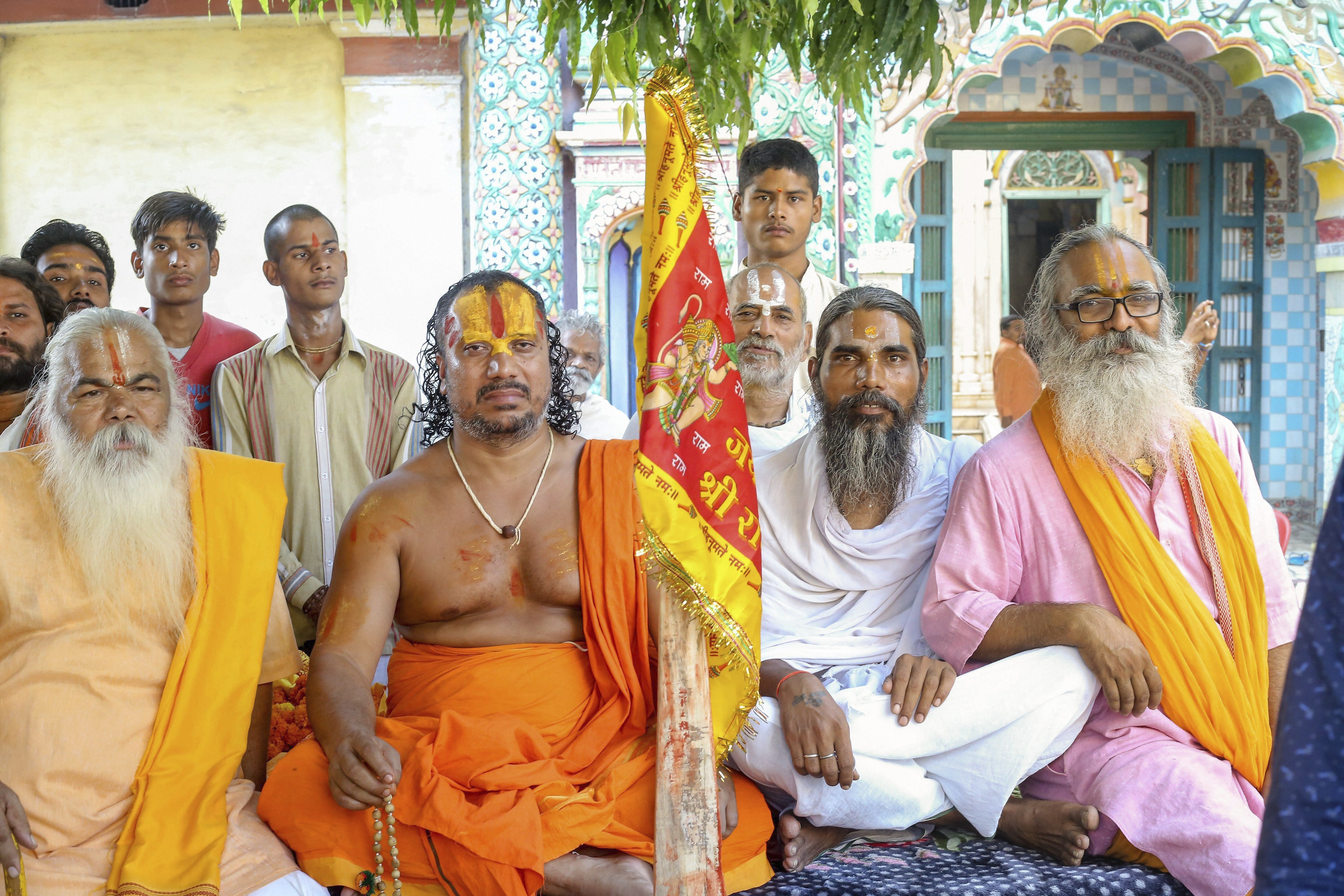 Mahant Param Das (2nd L) with other sadhus during his indefinite hunger strike for construction of the Ram Temple, at Ramghat in Ayodhya - PTI
