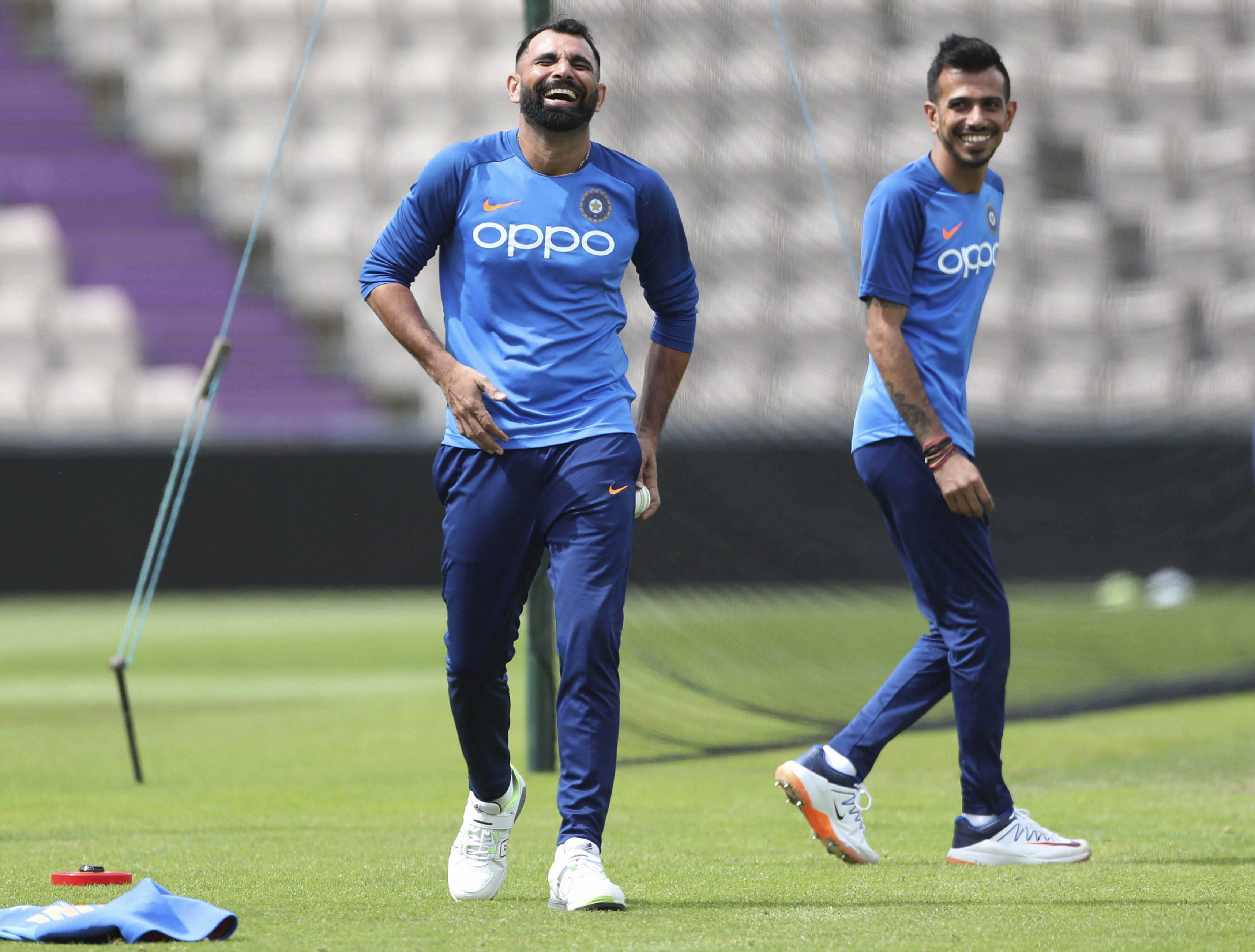 India's Mohammed Shami, left, and Yuzvendra Chahal share a laugh in the nets during a training session ahead of their Cricket World Cup match against South Africa at Ageas Bowl in Southampton - PTI
