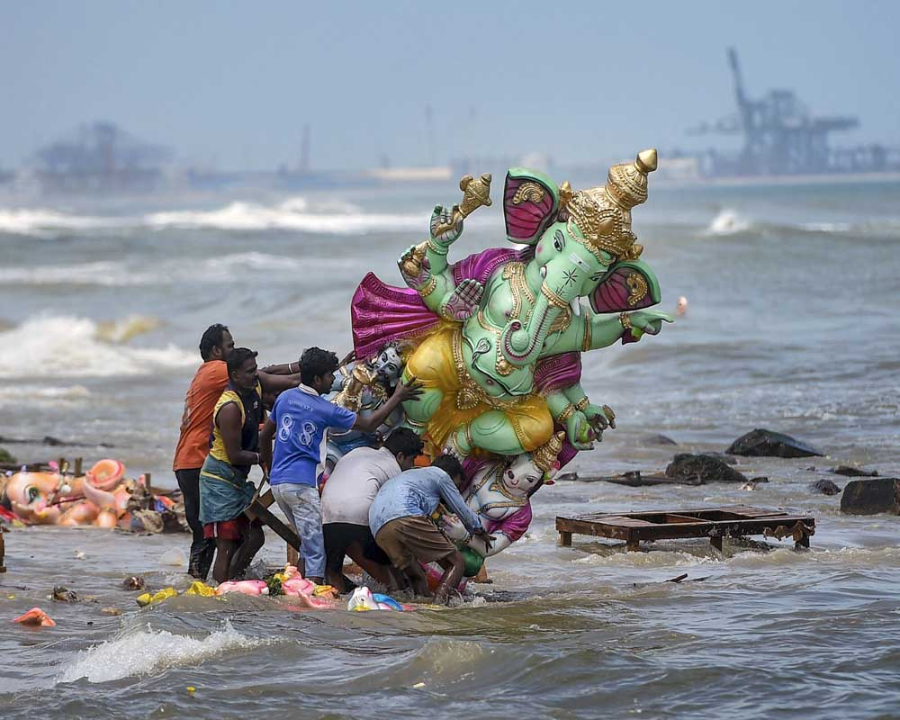 Devotees immerse an idol of Lord Ganesha in the sea during the Ganesh festival in Chennai - PTI