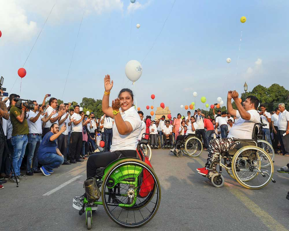 Participants during a wheelchair rally, organised to mark Spinal Cord Injury Day, in New Delhi - PTI