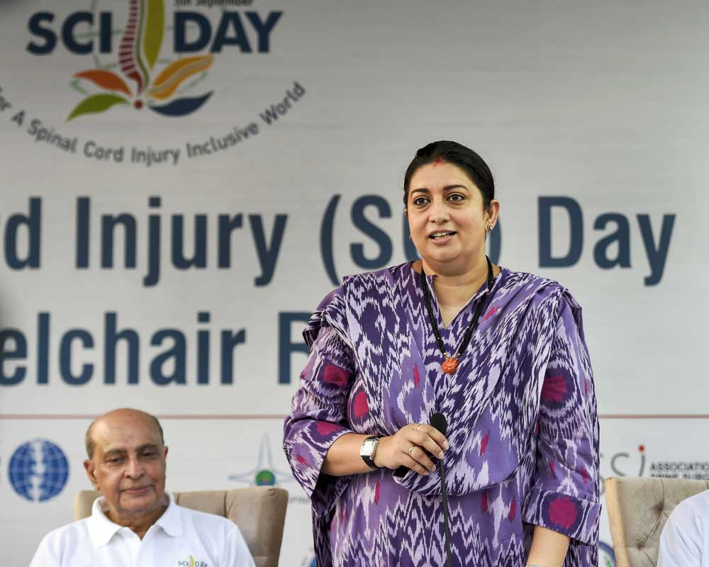 Union Women and Child Development Minister Smriti Irani speaks during a wheelchair rally, organised to mark Spinal Cord Injury Day, in New Delhi - PTI