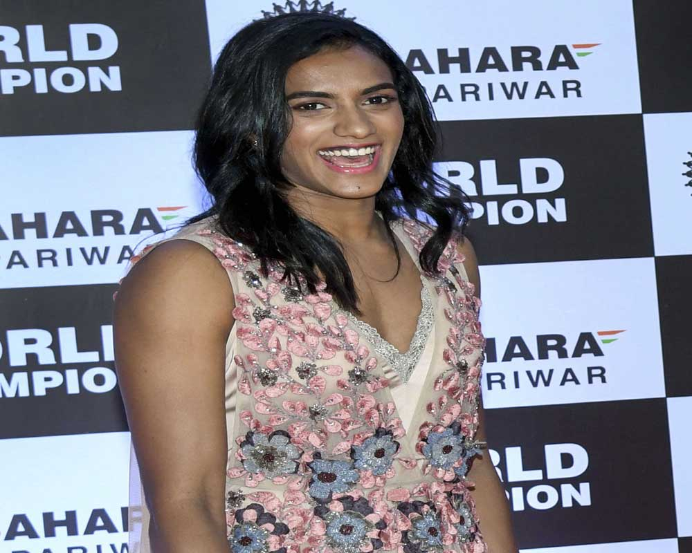 World badminton champion P V Sindhu smiles as she is felicitated by the Sahara Group during an event, in Mumbai - PTI