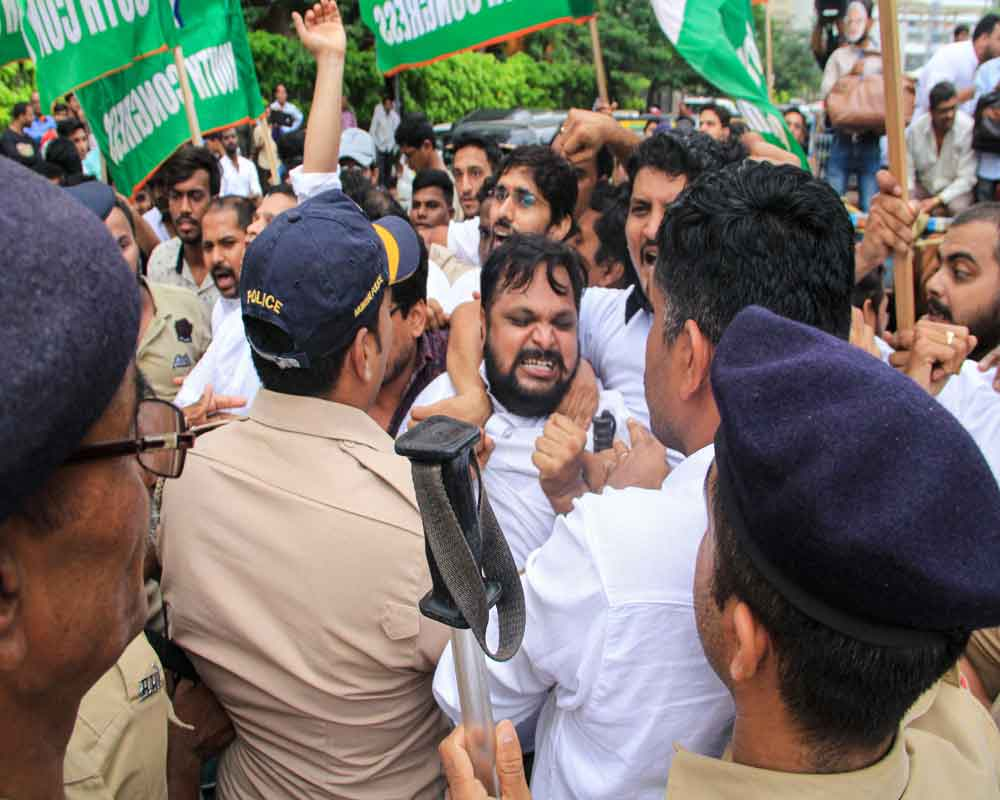 Police detain Youth Congress workers who were staging a protest over the meeting of some Karnataka congress MLAs with BJP leaders, outside a hotel in Mumbai - PTI