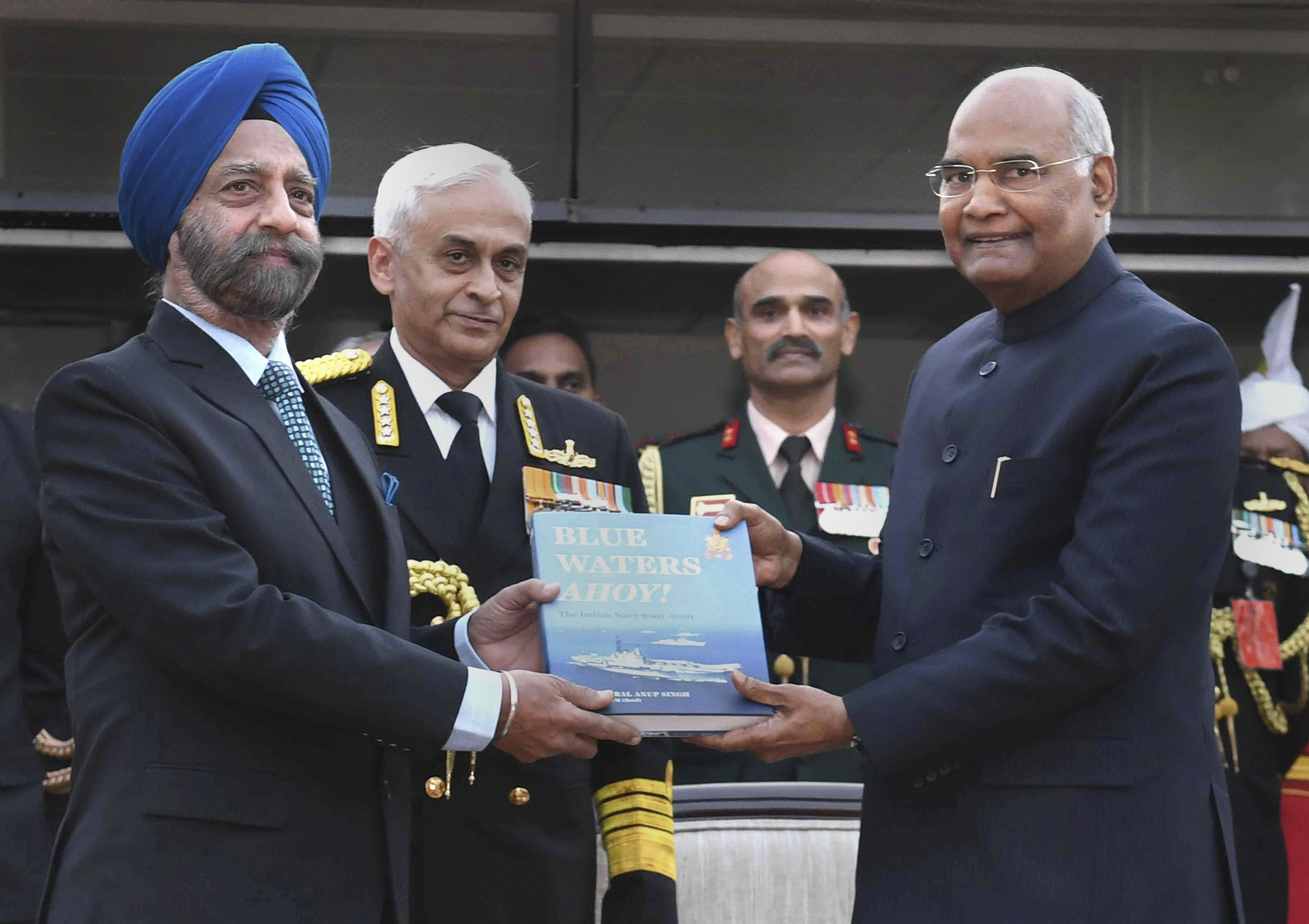 President Ram Nath Kovind along with Navy chief Admiral Sunil Lanba releases a publication during the Navy Day reception, in New Delhi - PTI