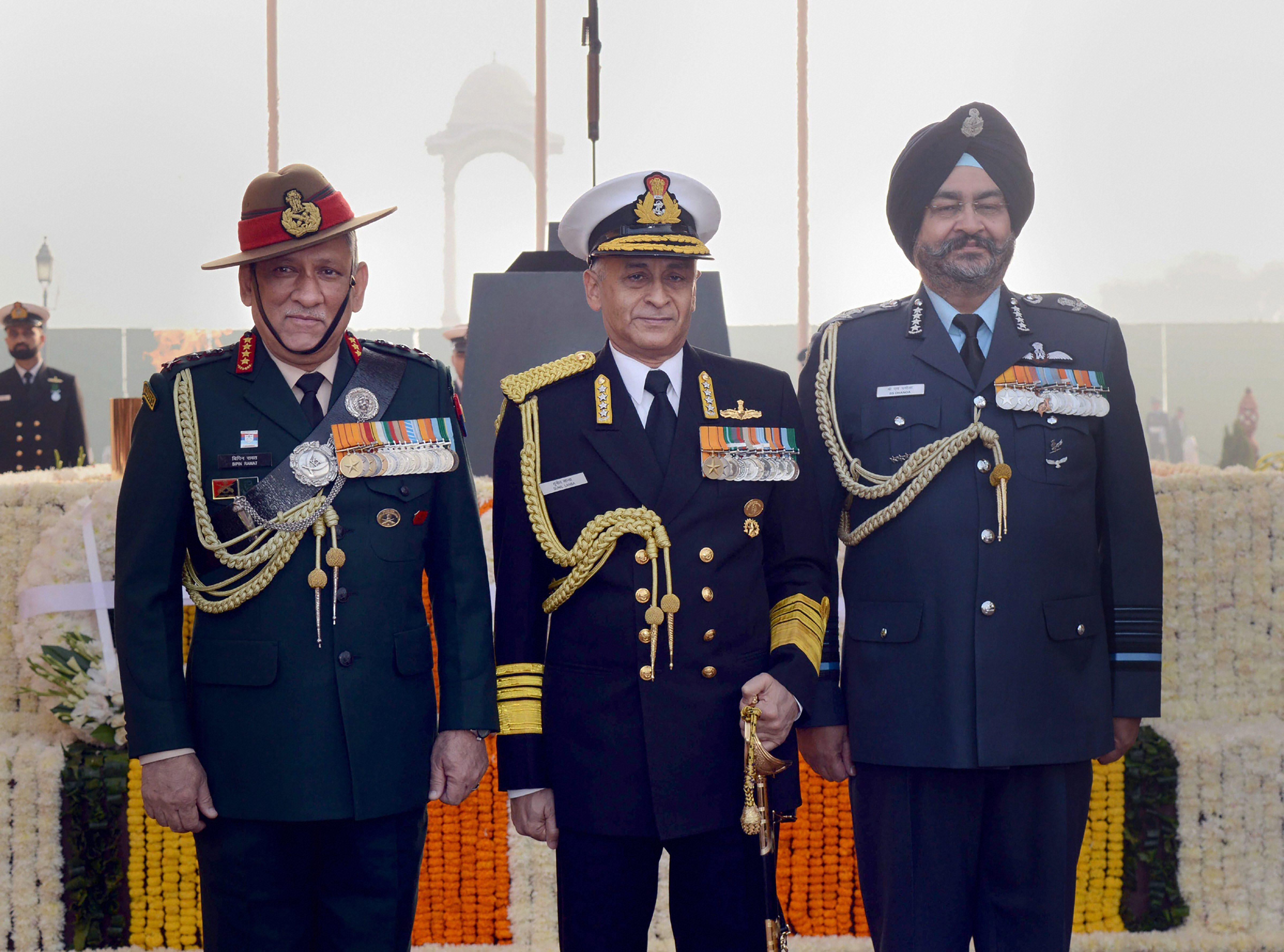 Chief of Army Staff General Bipin Rawat, Chief of Naval Staff Admiral Sunil Lanba and Chief of Air Staff Air Chief Marshal BS Dhanoa on the occasion of Navy Day at Amar Jawan Jyoti, India Gate, in New Delhi - PTI