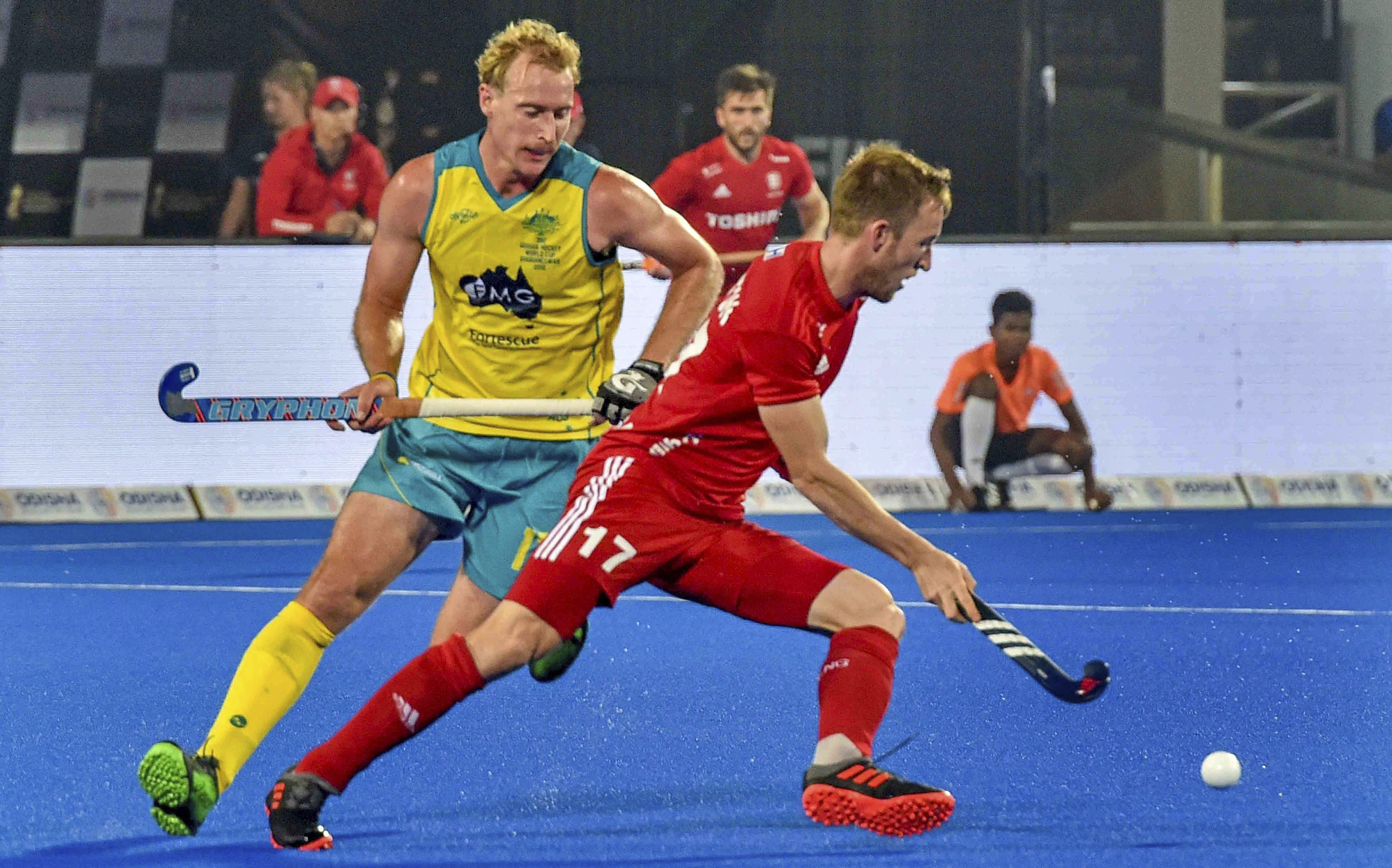 Australia's (yellow) captain Aran Zalewsk in action during a match against England's Barry Middleton, at Men's Hockey World Cup 2018, at Kalinga Stadium in Bhubaneswar - PTI