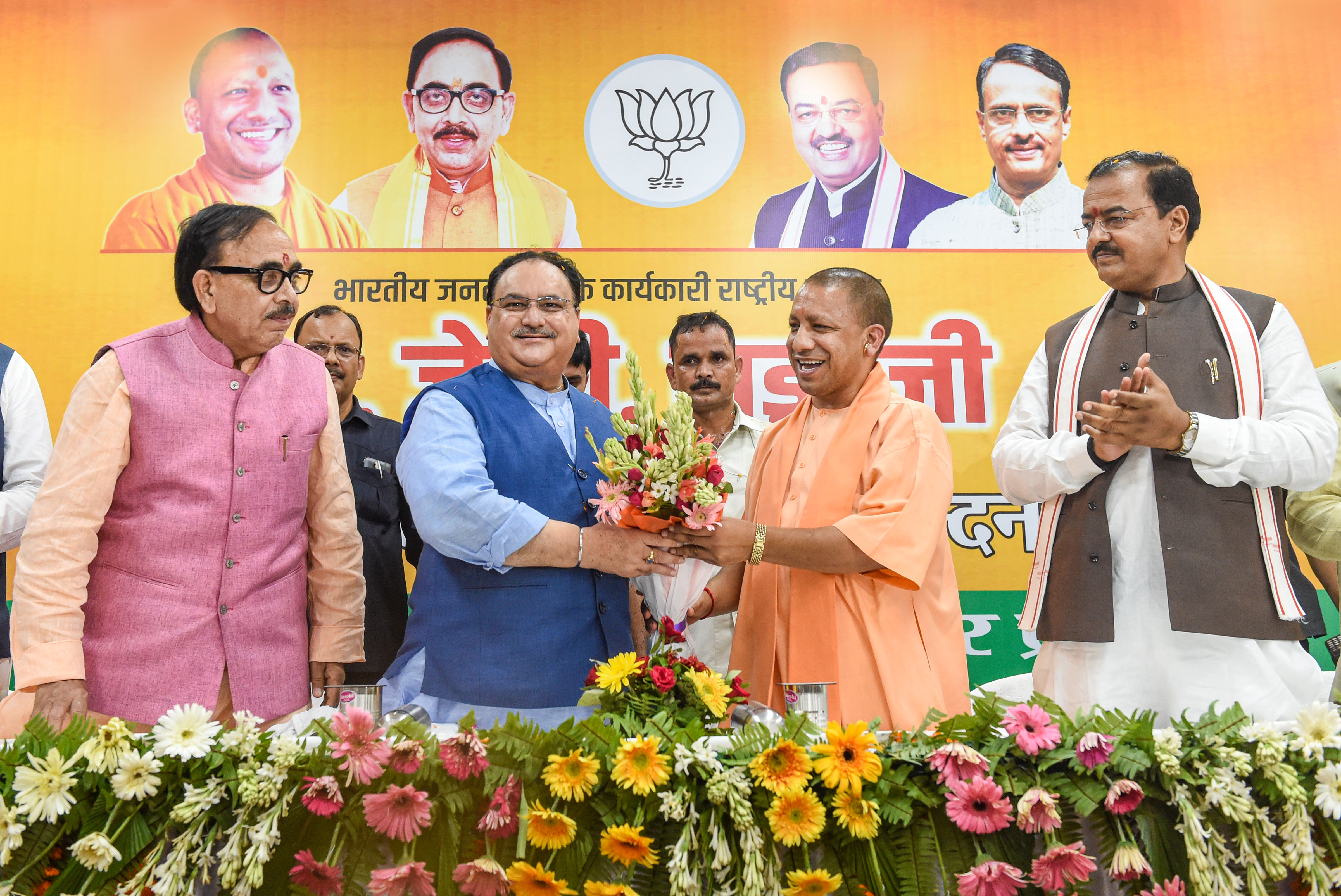BJP National Working President JP Nadda receives a bouquet from Uttar Pradesh Chief Minister Yogi Adityanath, at BJP party office in Lucknow - PTI