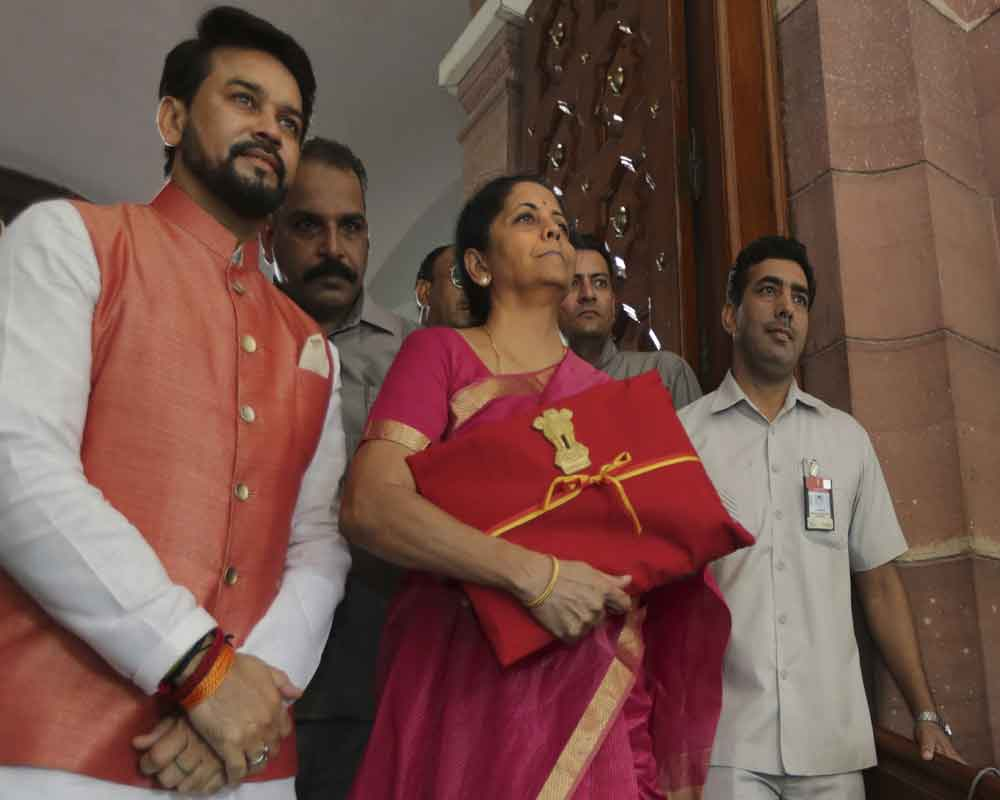 Finance Minister Nirmala Sitharaman carries annual federal budget for the year 2019-20 - PTI