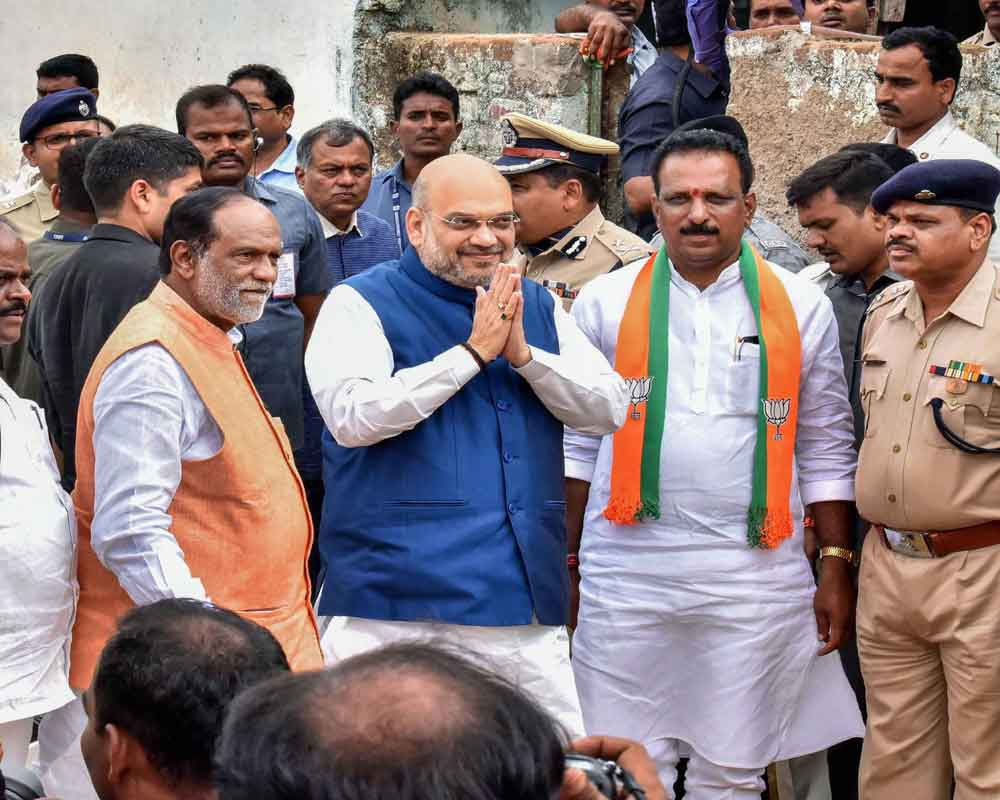 Home Minister Amit Shah greets his supporters during an event to provide BJP membership to ST Mahila Soni Naik, at Ranganayakula Thanda in Mamidipalli village of Ranga Reddy district - PTI