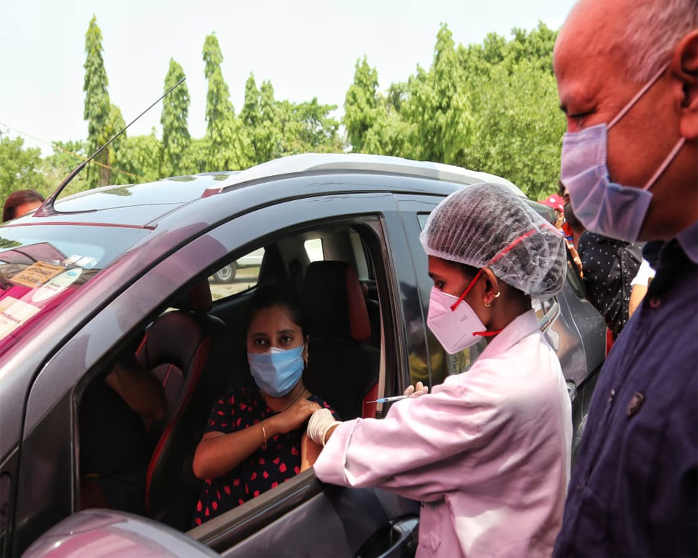 People taking covid - 19 vaccine at a drive-through vaccination facility at Akshardham. The Deputy CM Manish Sisodia also seen in New Delhi on Monday 07 June 2021 - IANS