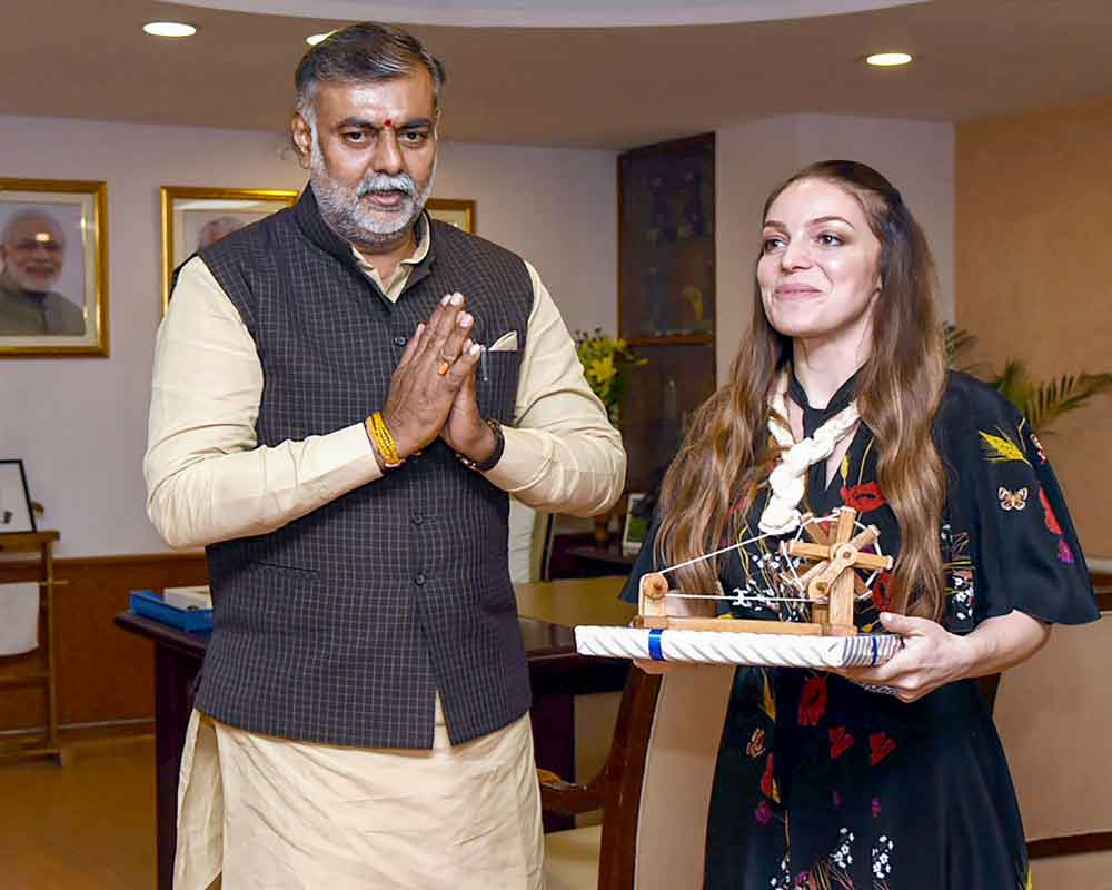 Minister of State for Culture and Tourism (I/C) Prahalad Singh Patel presents the traditional Charkha as souvenir to the Head of the Federal Agency for Tourism, Russia - PTI