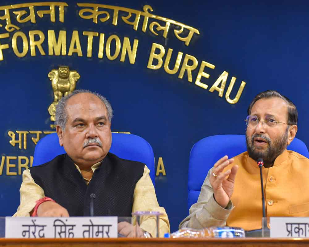 Union Ministers Narendra Singh Tomar and Prakash Javadekar (R) during a cabinet briefing, in New Delhi - PTI