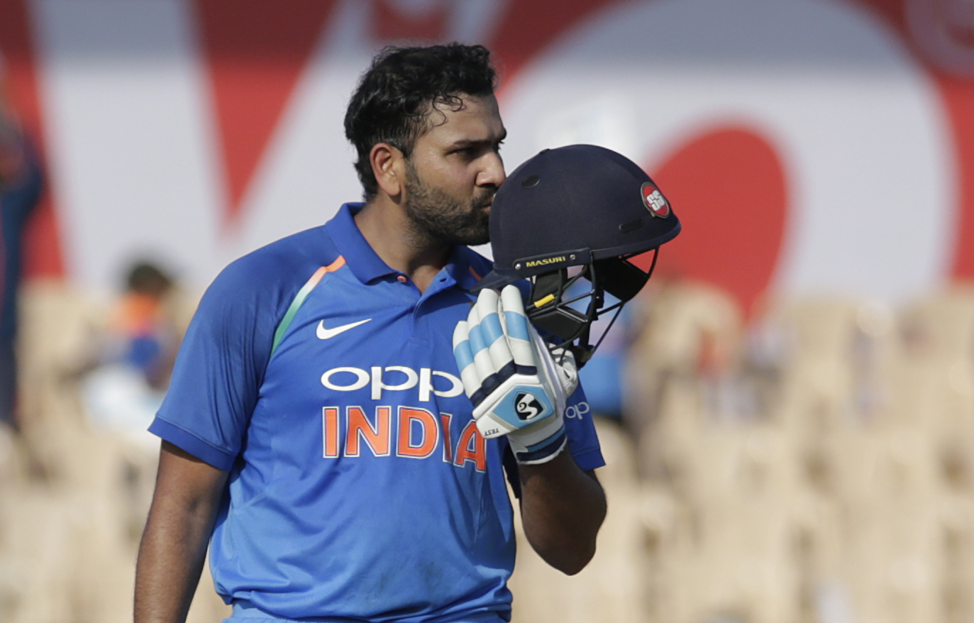India's Rohit Sharma celebrate scoring a century during the fourth one-day international cricket match between India and West Indies in Mumbai - AP