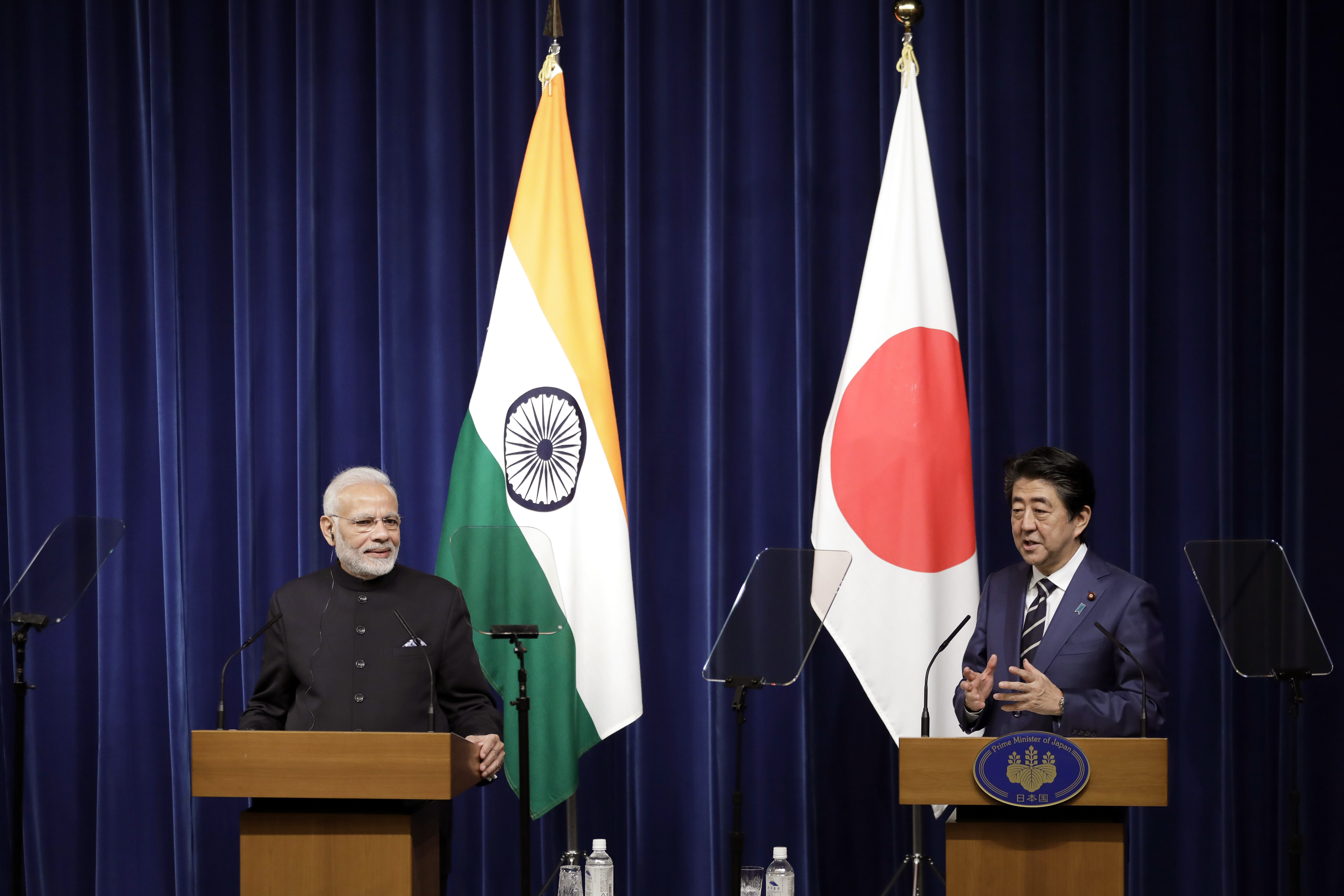 Indian Prime Minister Narendra Modi, left, listens as Japan's Prime Minister Shinzo Abe speaks during a joint news conference at Abe's official residence in Tokyo - AP