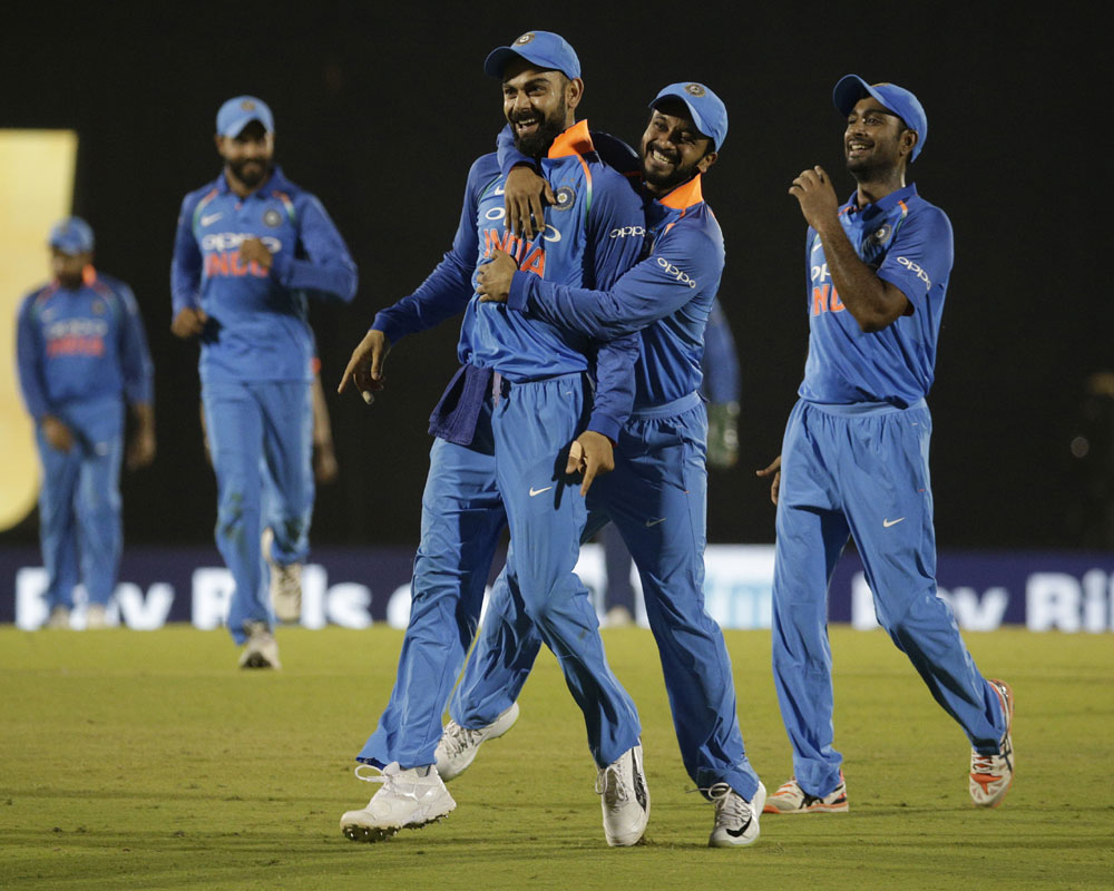 India's players celebrates the dismissal of West Indies' Kieran Powell during the fourth one-day international cricket match between India and West Indies in Mumbai - AP