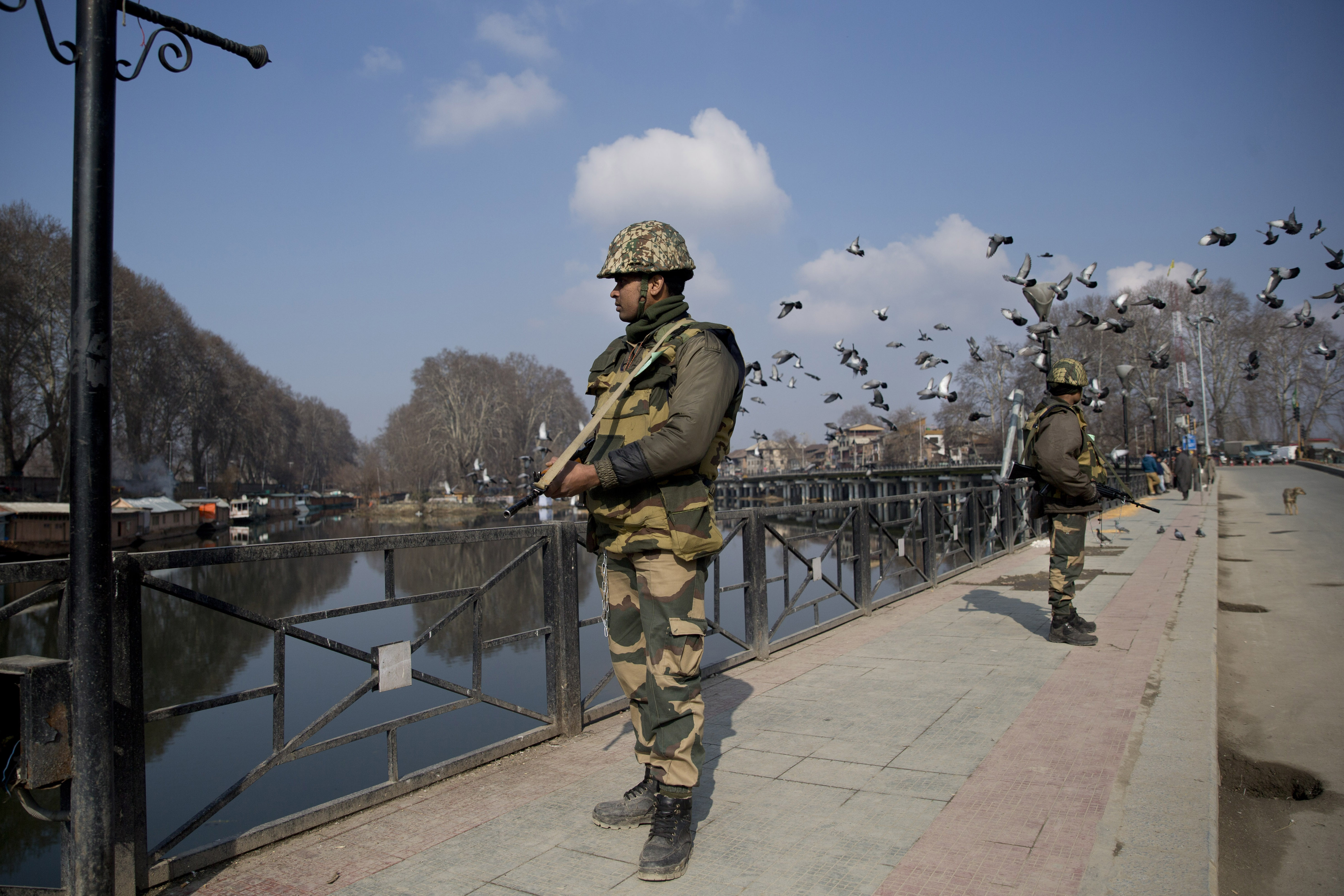 Indian paramilitary soldiers stand guard on a deserted street during a strike in Srinagar, Indian controlled Kashmir - AP