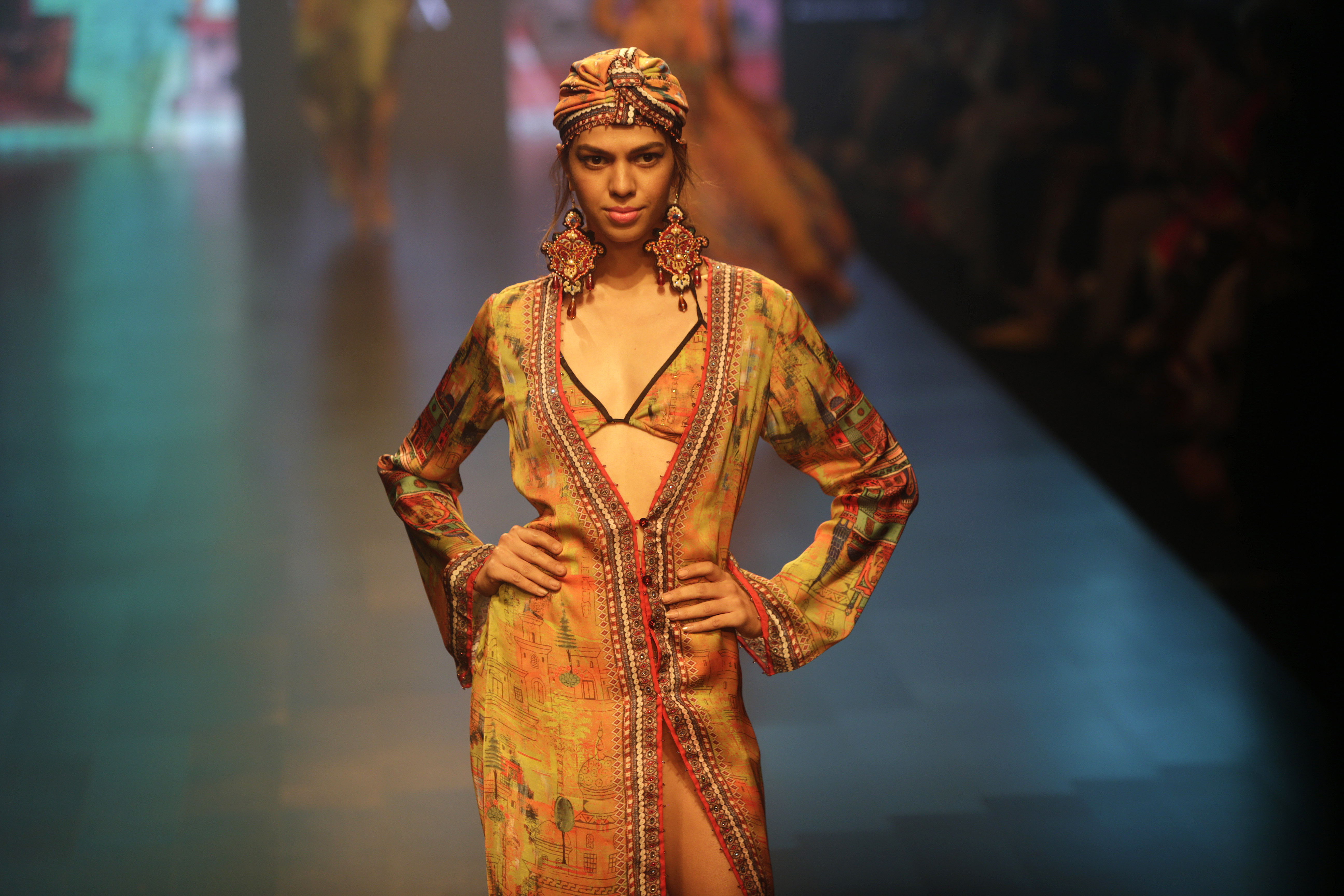 A model displays a creation by Rajdeep Ranawat during the Lakme Fashion Week in Mumbai - AP