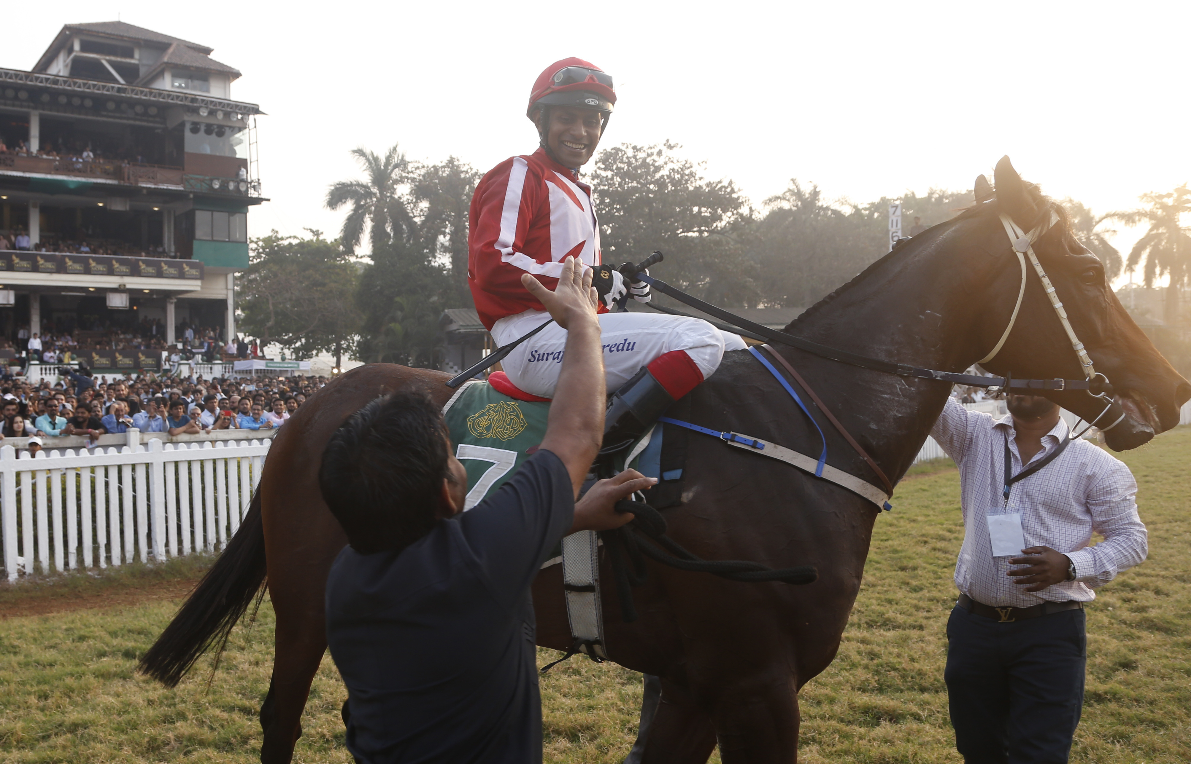 Jockey Suraj Narredu, is greeted after he won the Indian Derby 2019 at the Mahalaxmi race course in Mumbai - AP