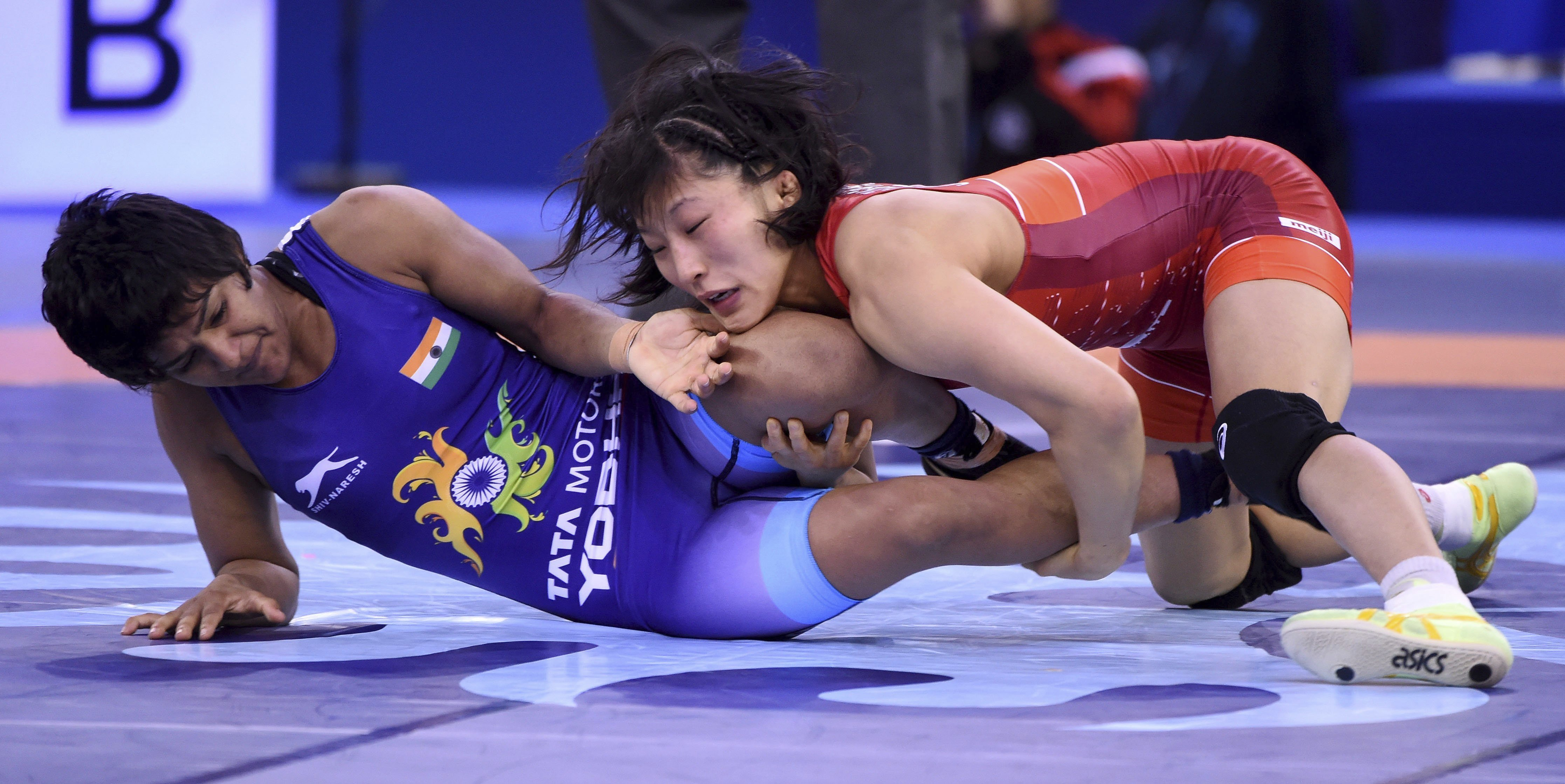 Yui Susaki, in red, of Japan wins against Ritu Phogat of India in the quarterfinal of the women's 50kg category of the Wrestling World Championships in Budapest - AP