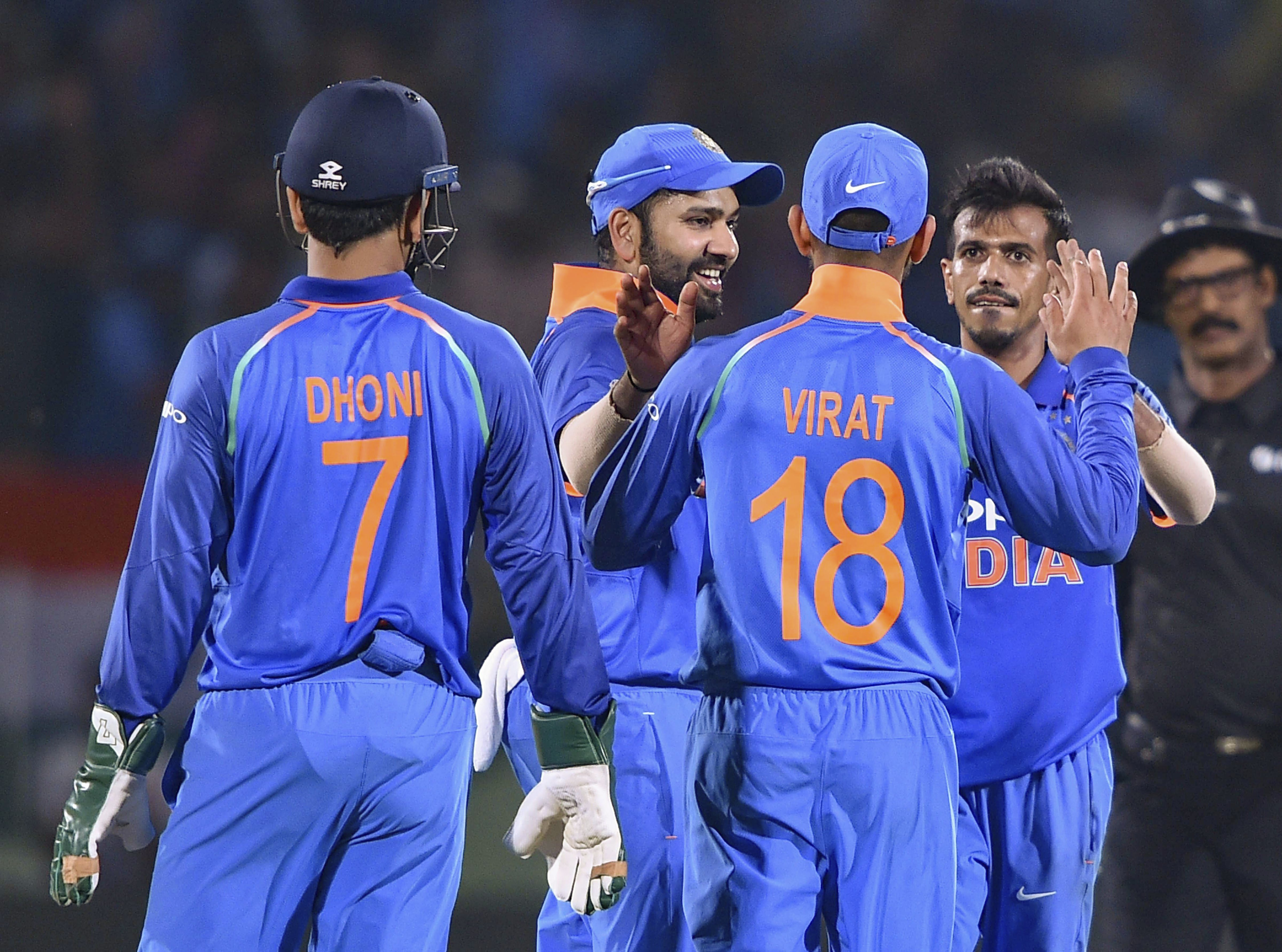 Indian bowler YS Chahal celebrates with teammates after dismissing West Indies batsman SO Hetmyer during the 2nd ODI cricket match in Visakhapatnam - PTI