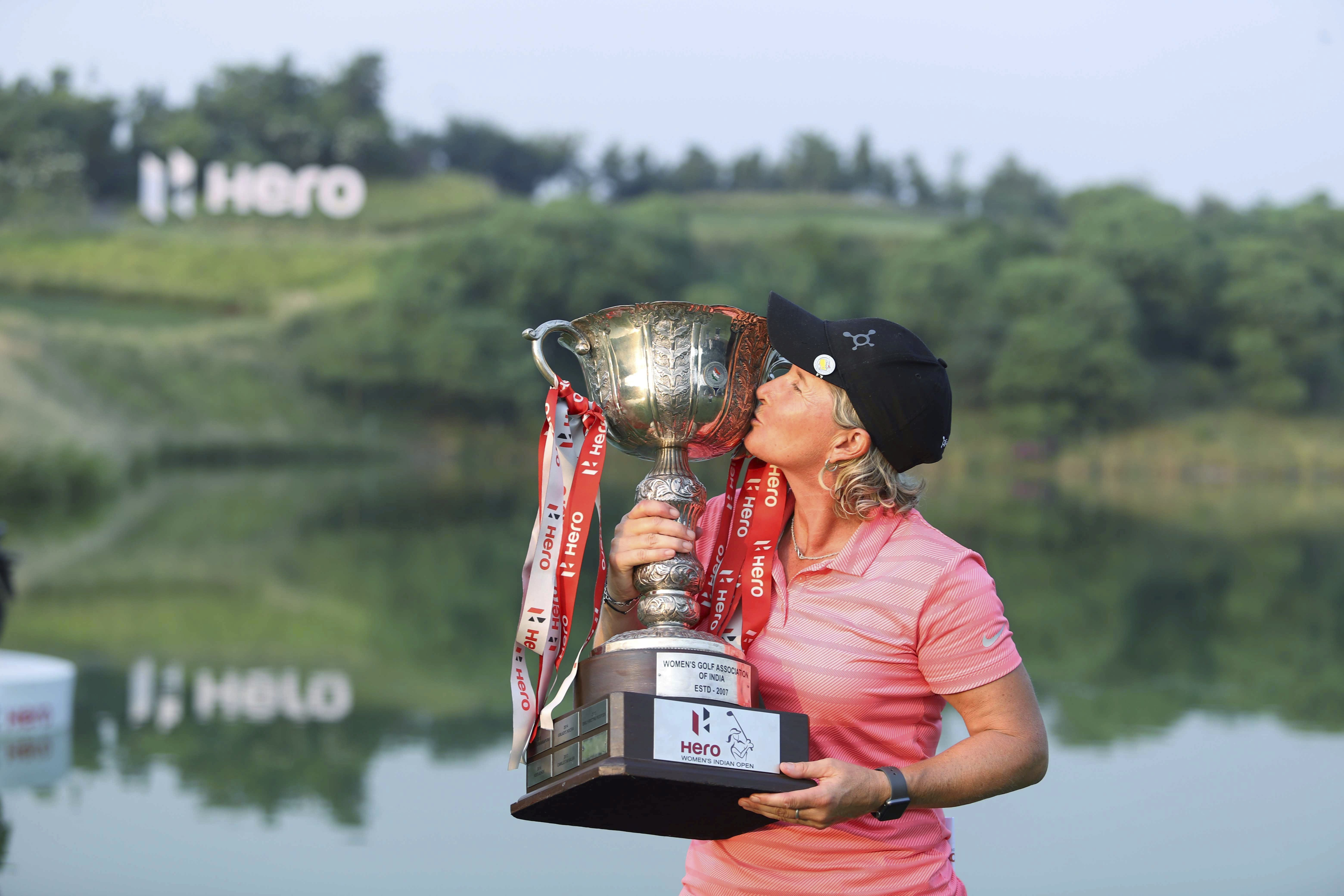Women's Indian Open 2018 Champion Becky Morgan of Wales poses for photos with the trophy, in Gurugram - PTI