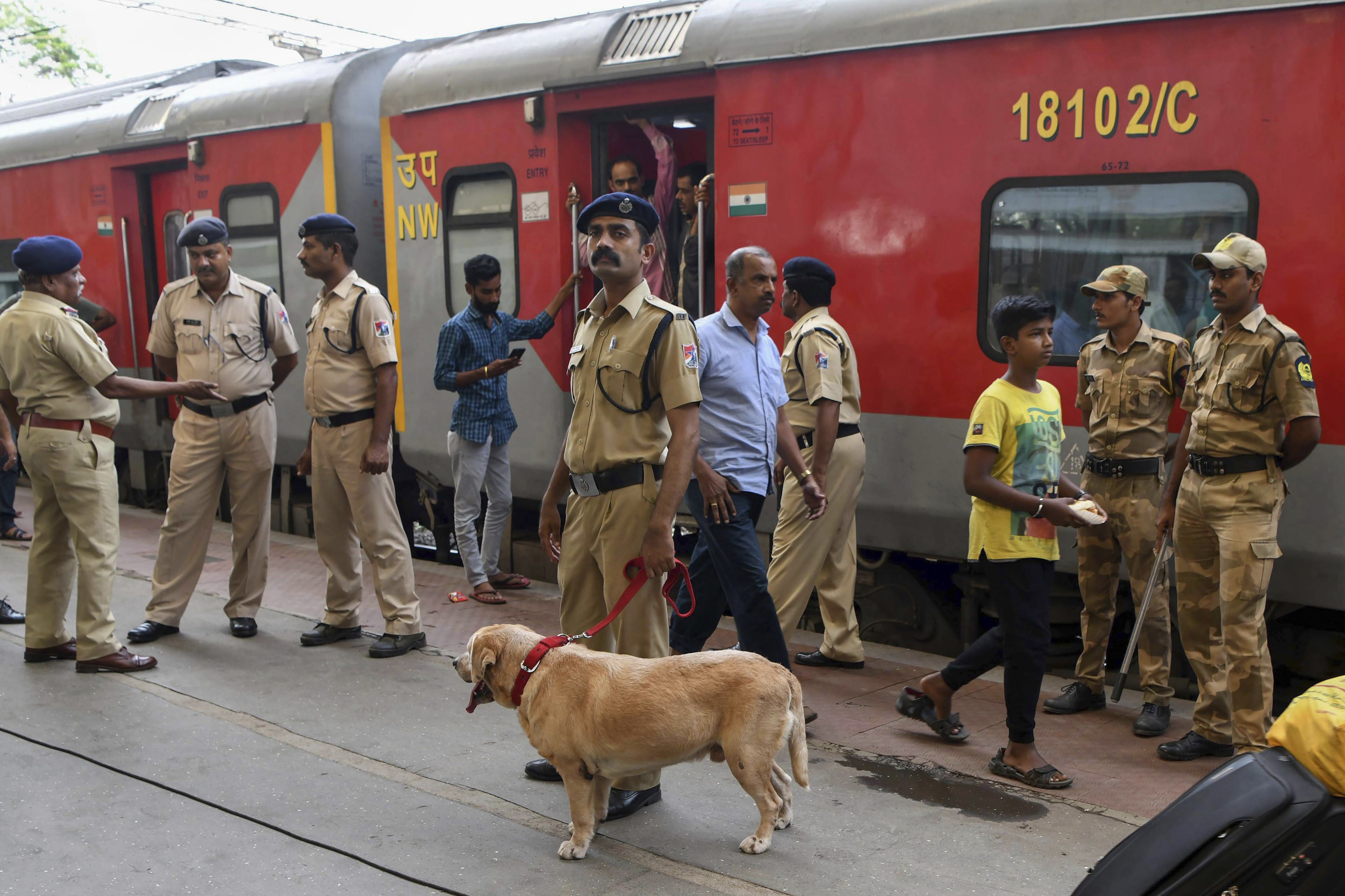 Navi Mumbai Police conduct search drive with Railway Police and Dog Squad inside 22476 Coimbatore-BIkaner Superfast Train after a bomb threat call, at Panvel Railway Station in Navi Mumbai - PTI