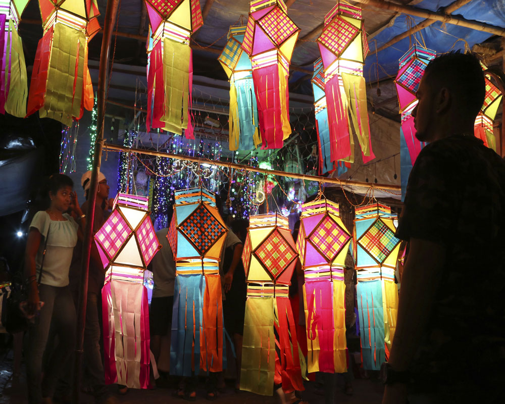 Colorful lanterns are displayed for sale at roadside stalls ahead of Diwali, the Hindu festival of lights, in Mumbai - AP