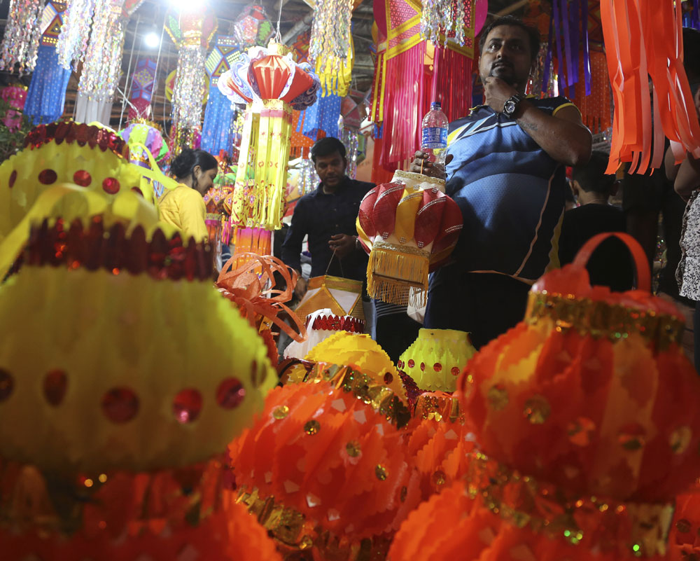 Indians shop for lanterns at roadside stalls ahead of Diwali, the Hindu festival of lights, in Mumbai - AP