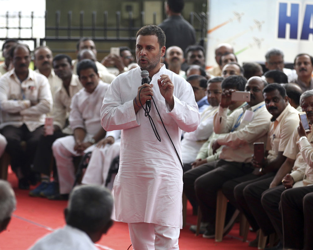India's opposition Congress party President Rahul Gandhi, speaks to working and retired employees of the state-run aerospace and defense company Hindustan Aeronautics Ltd (HAL) outside company's corporate headquarters in Bangalore, India - AP