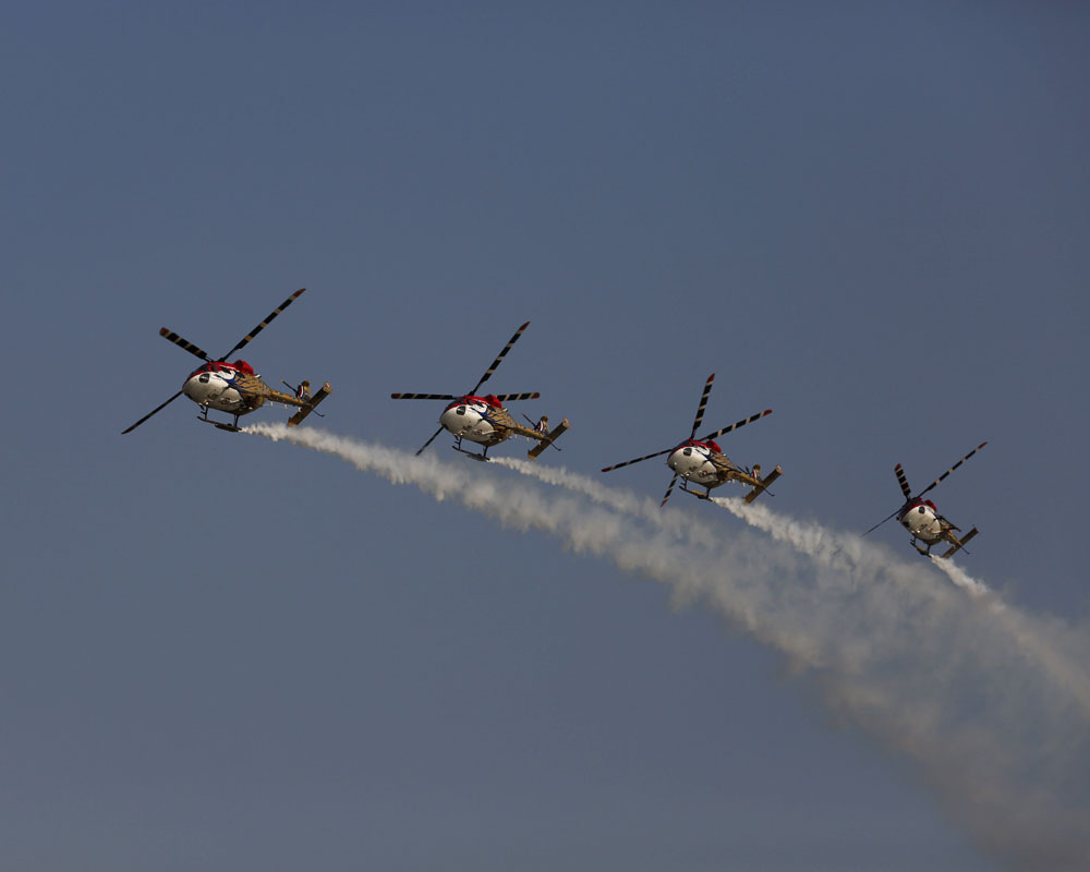 Indian Air Force (IAF) Sarang helicopters perform a display in Allahabad, India - AP