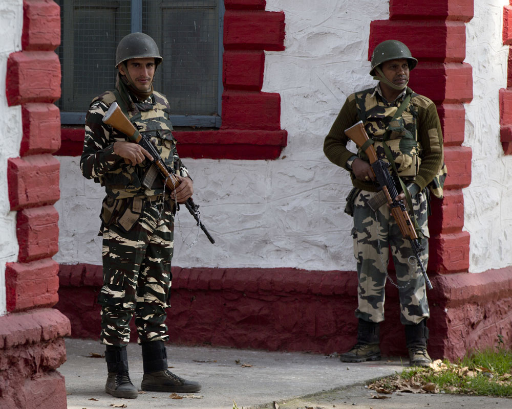 Indian paramilitary soldiers guard a poling station during third phase of local elections in Srinagar - AP