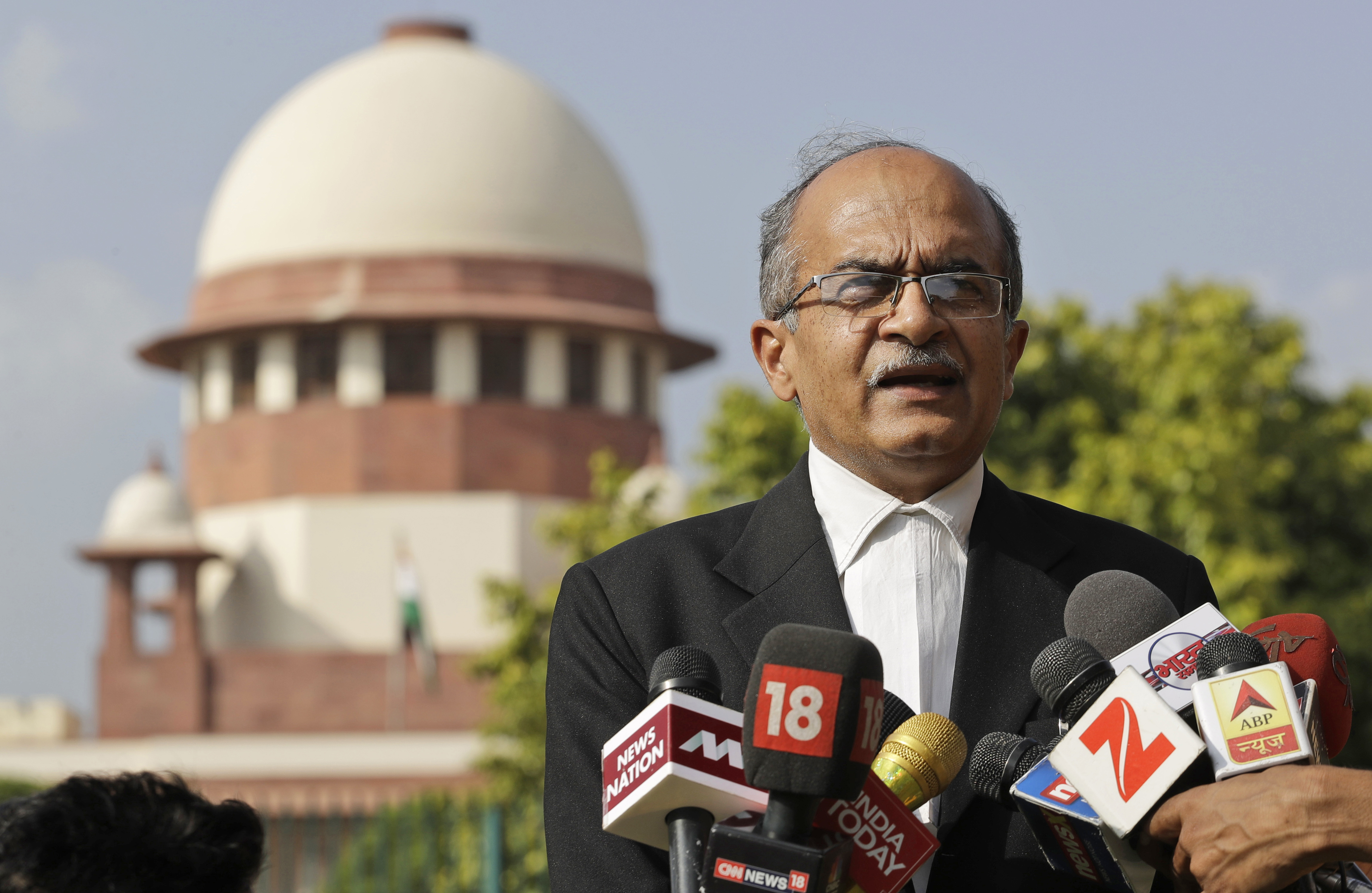 Indian lawyer and social activist Prashant Bhushan speaks to the journalists about the petition filed by two Rohingya Muslim refugees against their deportation to Myanmar, outside the Supreme Court in New Delhi - AP