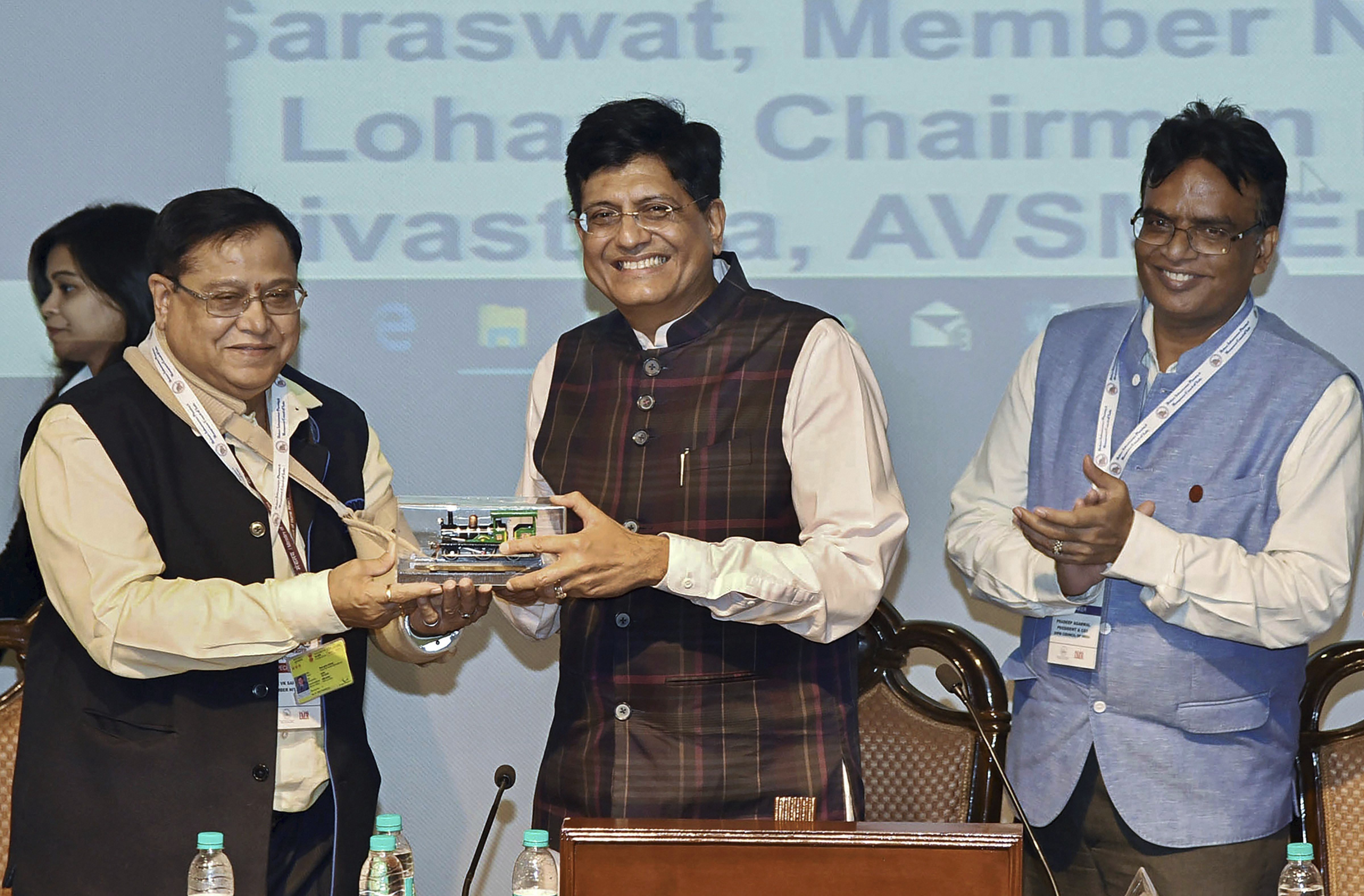 Union Minister for Railways and Coal Piyush Goyal is presented a memento by the Member, NITI Aayog V.K. Saraswat, at the inaugural function of the International Conference on Technological Advancements in Railways & Metro Projects, organised by DIPM Council (India), in New Delhi - PTI