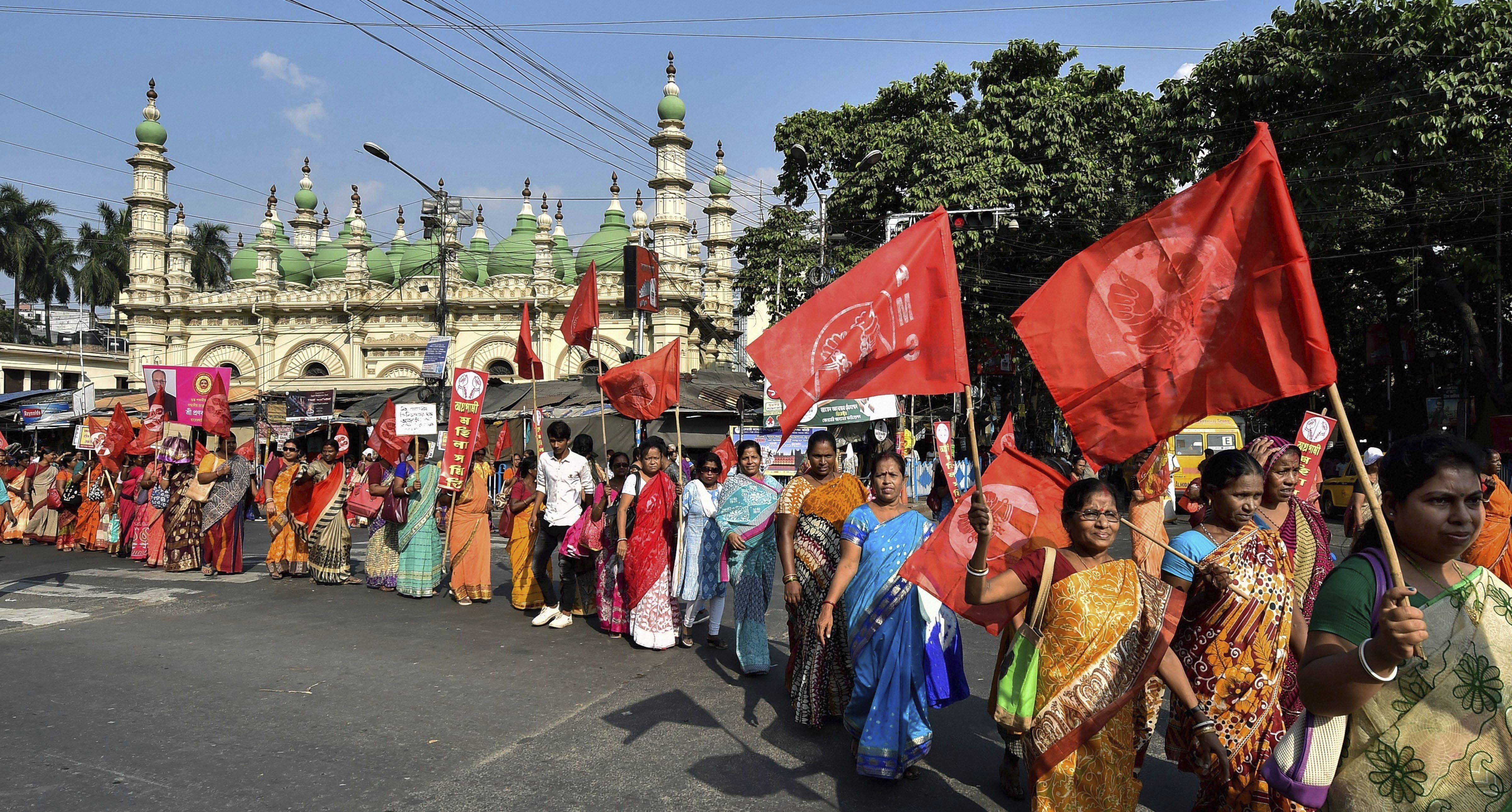Activists of All India Agragami Mohila Samity during their 'March to Governor House' protest over various demands, in Kolkata - AP