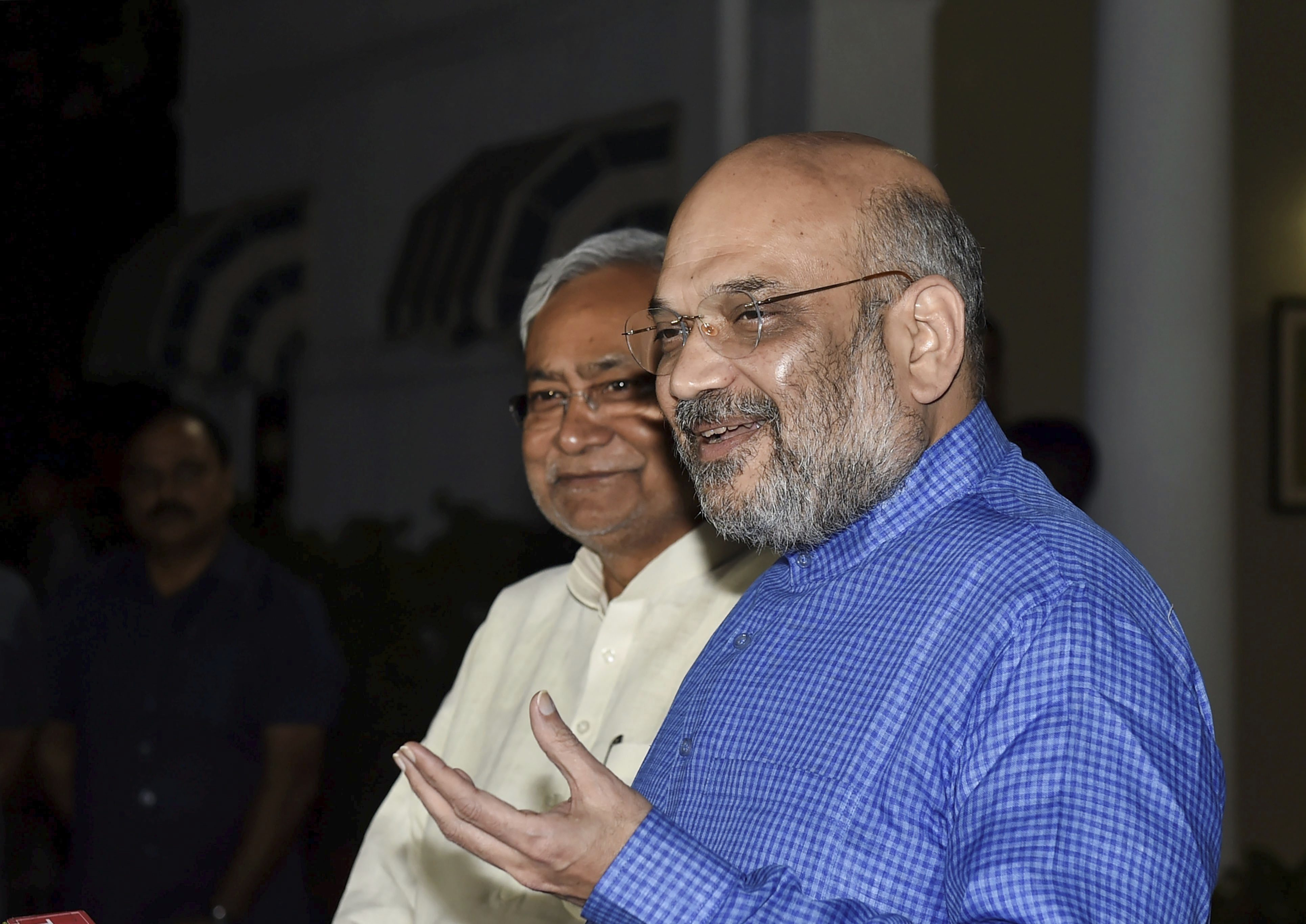 BJP President Amit Shah and Bihar Chief Minister Nitish Kumar interact with the media at the former's residence in New Delhi - PTI