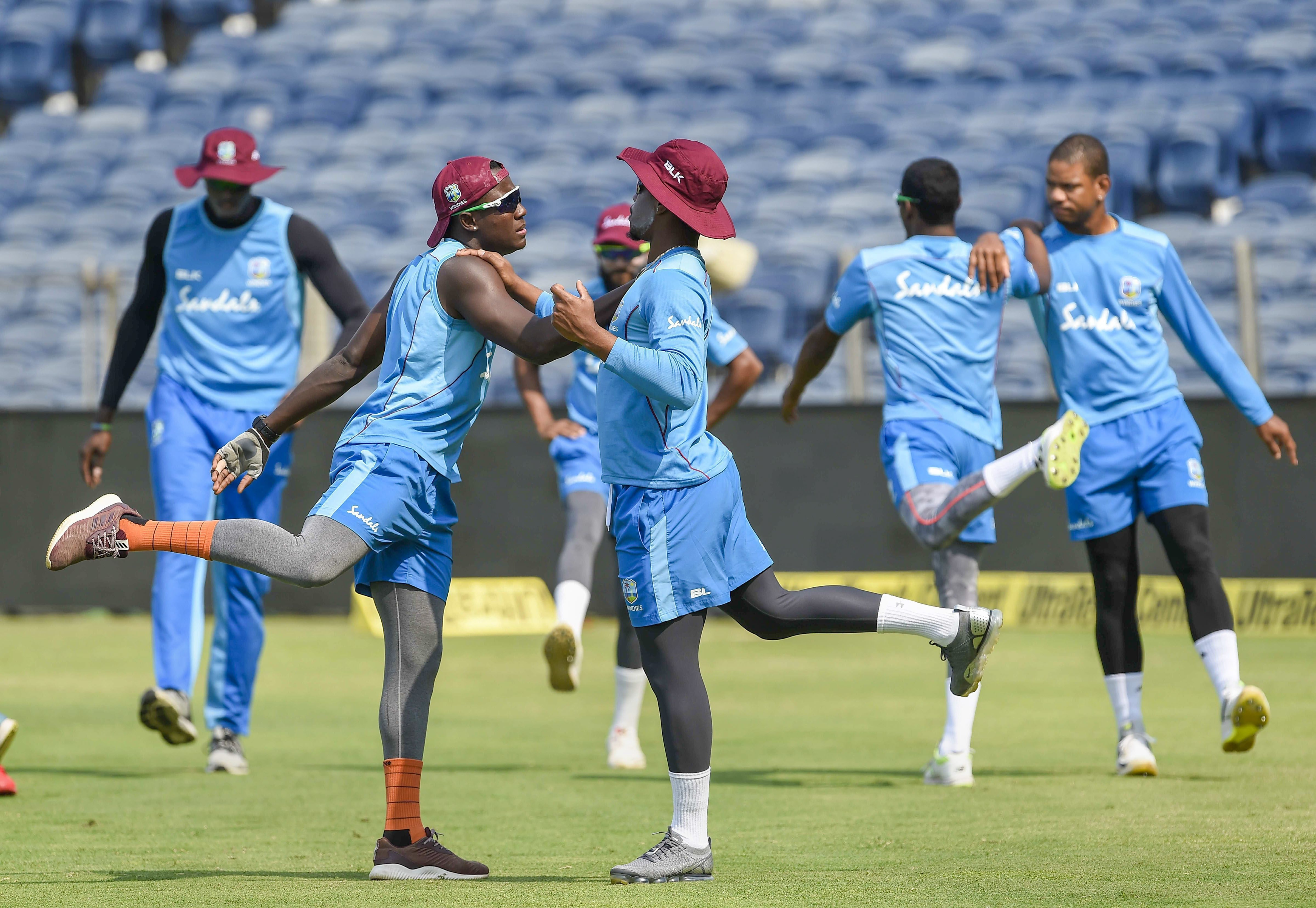 West Indies cricketers warm up during a practice session at the MCA Stadium in Pune - PTI
