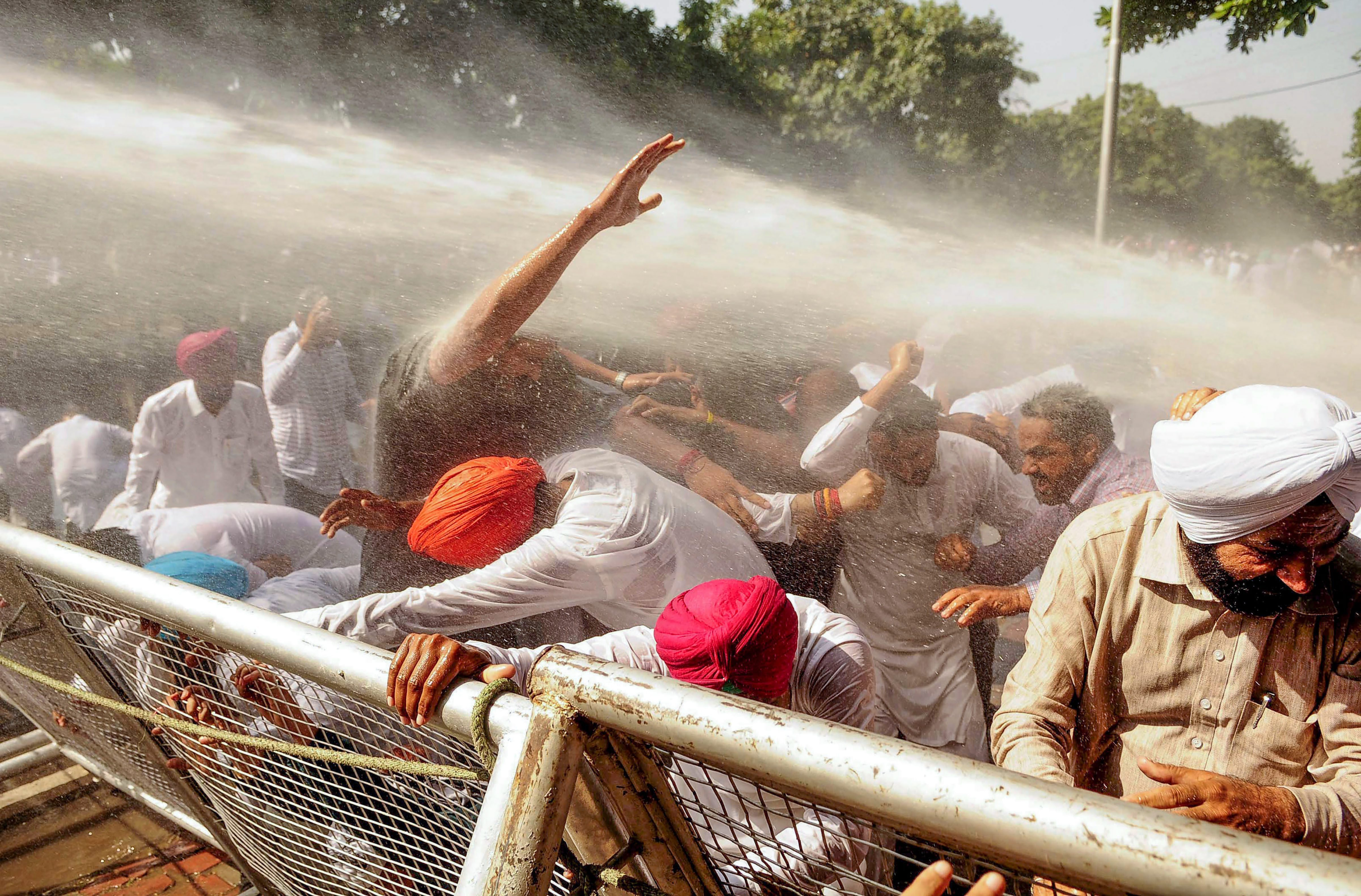 Congress workers face police water cannons during a protest against the Centre's move to divest CBI director Alok Verma of all powers and send him on leave, near the CBI office in Chandigarh - PTI