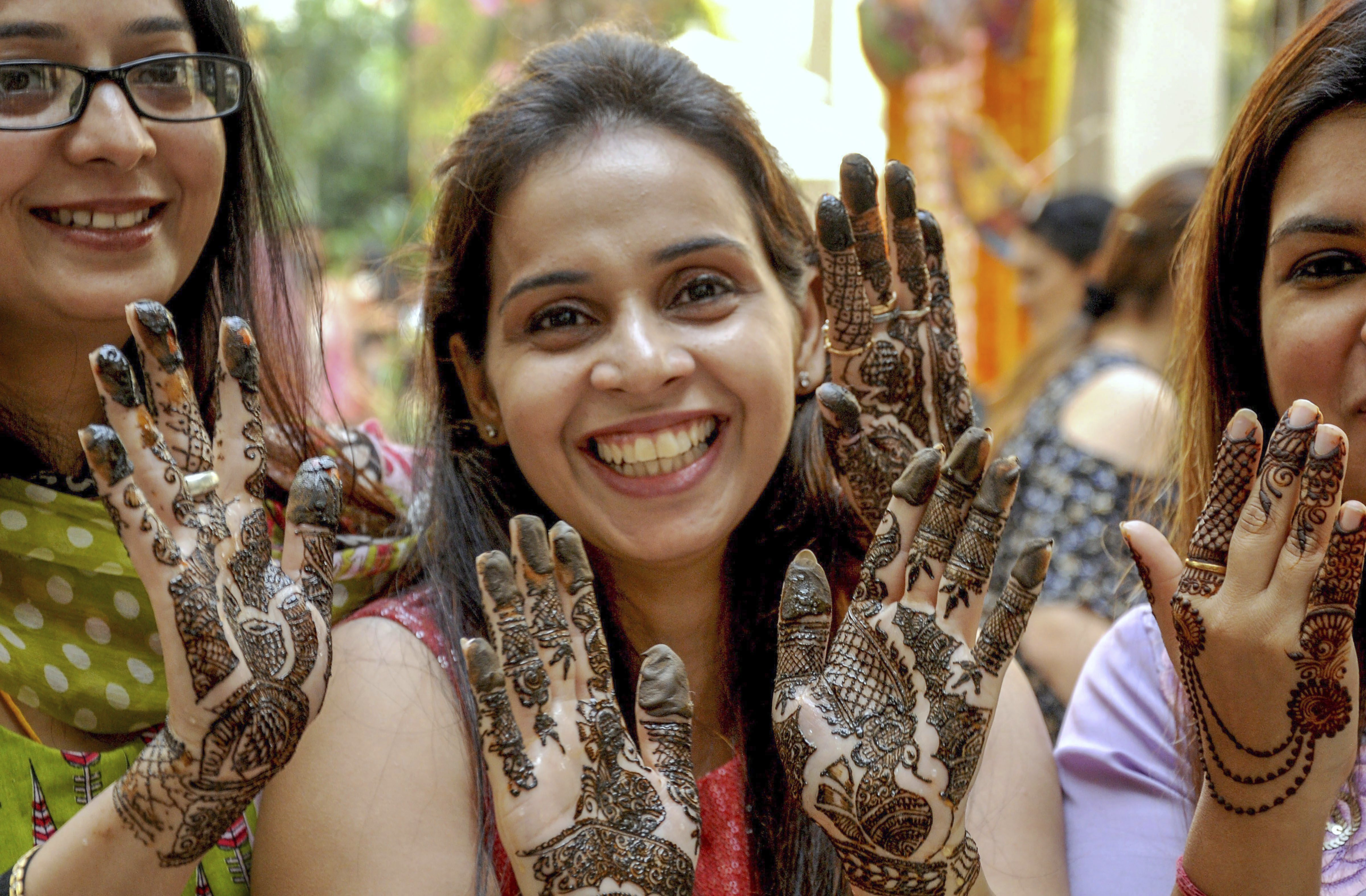 Woman show their 'menhdi' (henna) applied hands on the eve of Karva Chauth festival, in Amritsar - PTI
