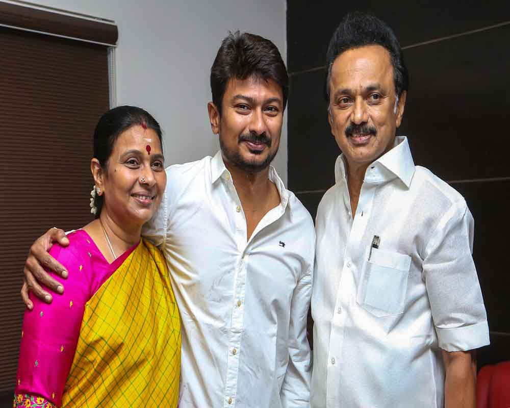 Actor and son of DMK president MK Stalin, Udhayanidhi, who was appointed as the party's youth wing secretary, poses for photos with his father and mother Durga Stalin, in Chennai - PTI