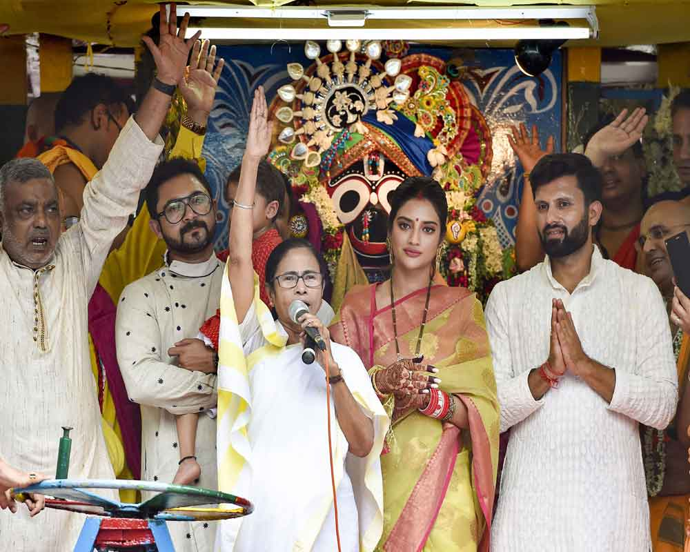 Kolkata: West Bengal Chief Minister Mamata Banerjee with newly elected Trinamool Congress MP and film actress Nusrat Jahan during Rath Yatra event organised by  ISKCON - PTI