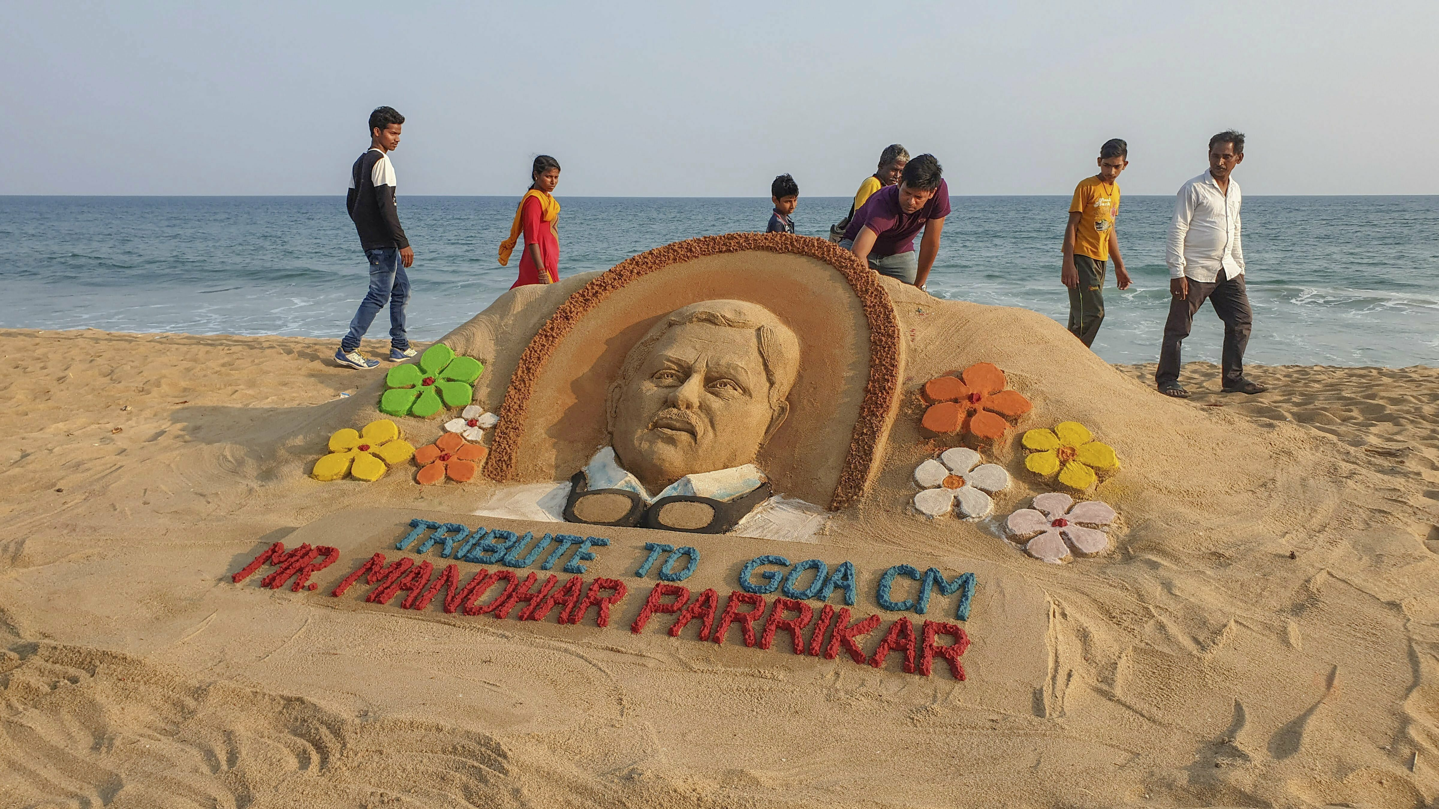 Sand artist Manas Sahoo makes a sand art to pay homage to Goa's Chief Minister Manohar Parrikar, who passed away battling pancreatic ailment yesterday, in Puri - PTI