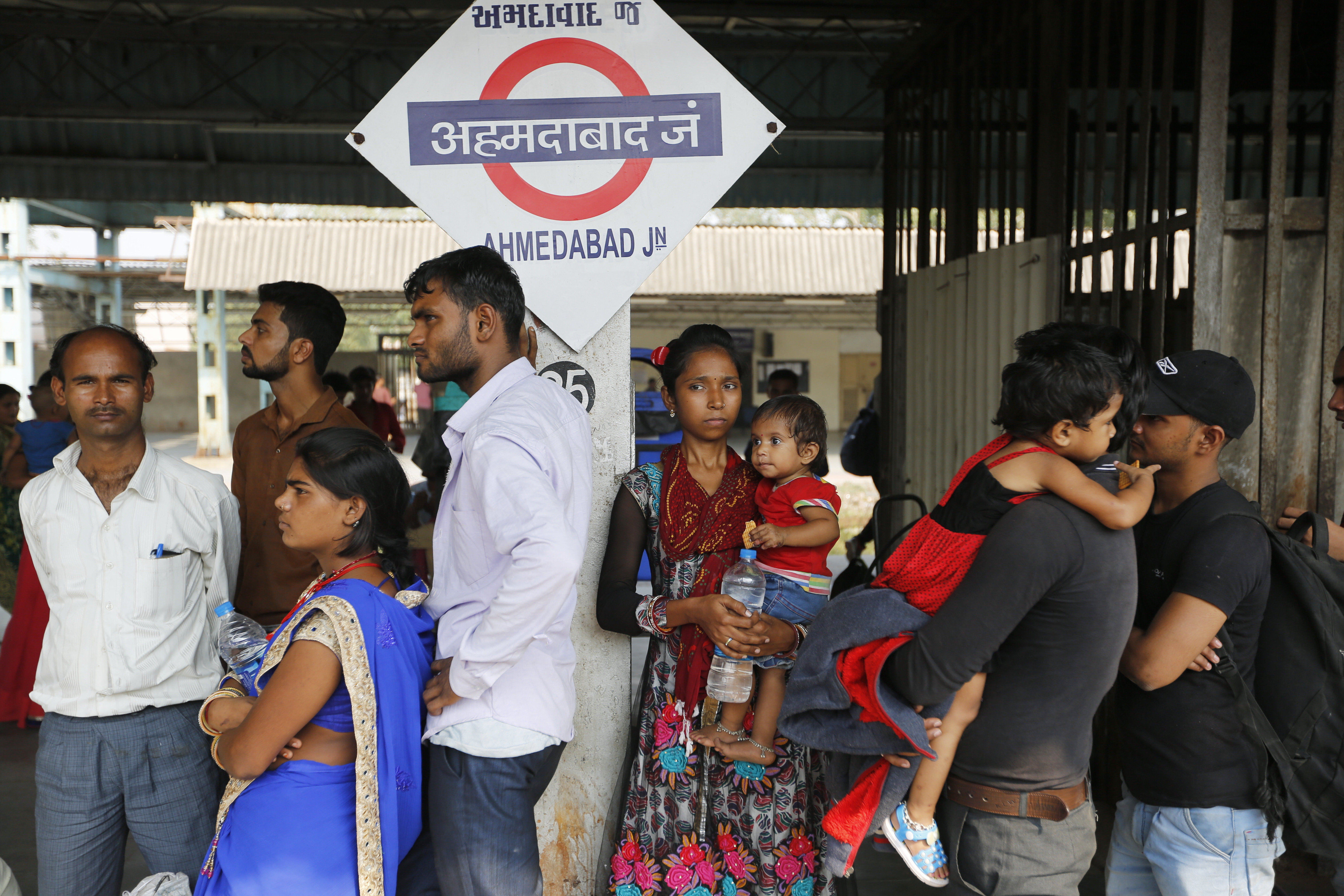 Indians stand in a queue to board a train to Uttar Pradesh, at a railway station in Ahmadabad, India - PTI