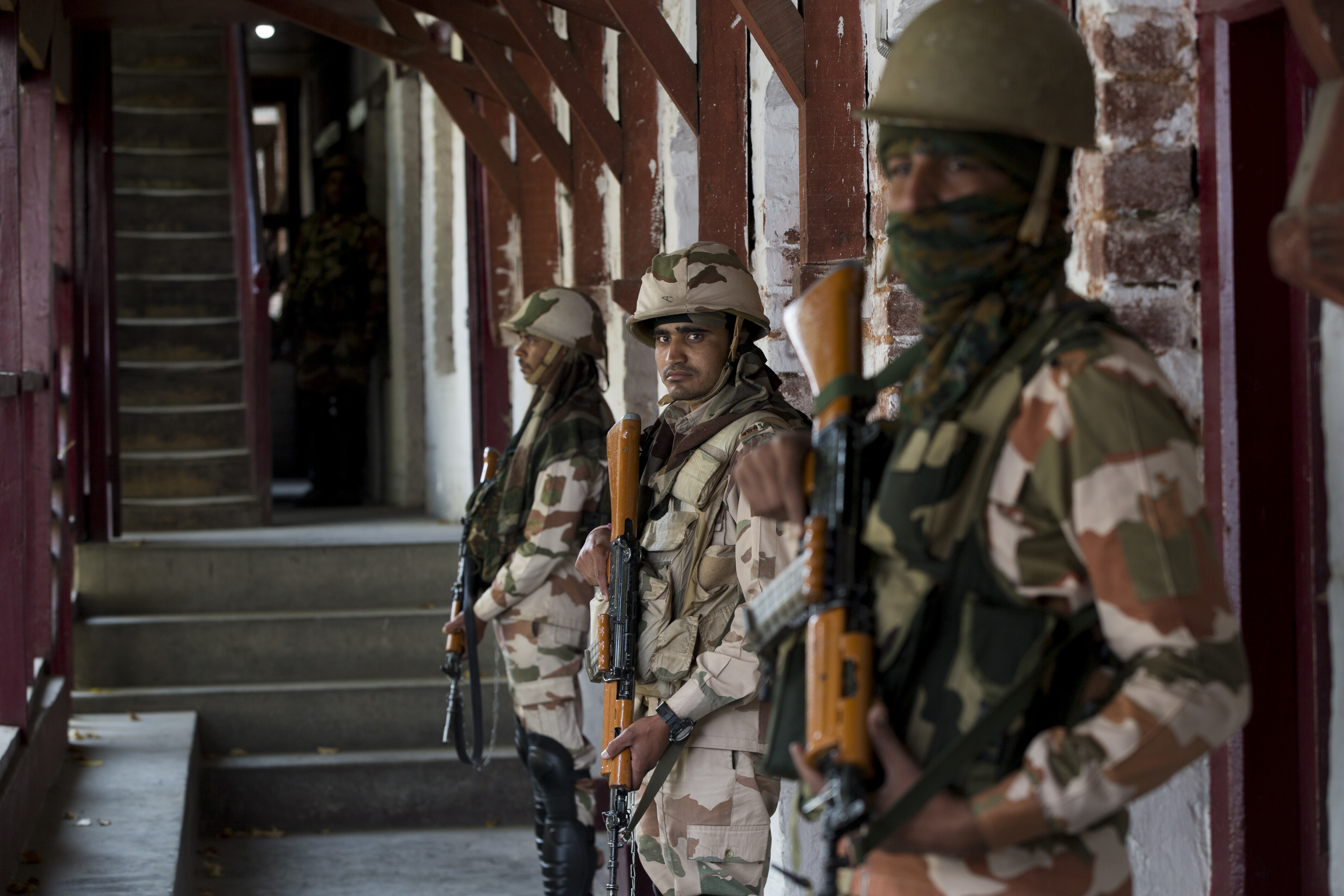 Indian paramilitary soldiers guard a poling station during second phase of local elections in Srinagar - AP