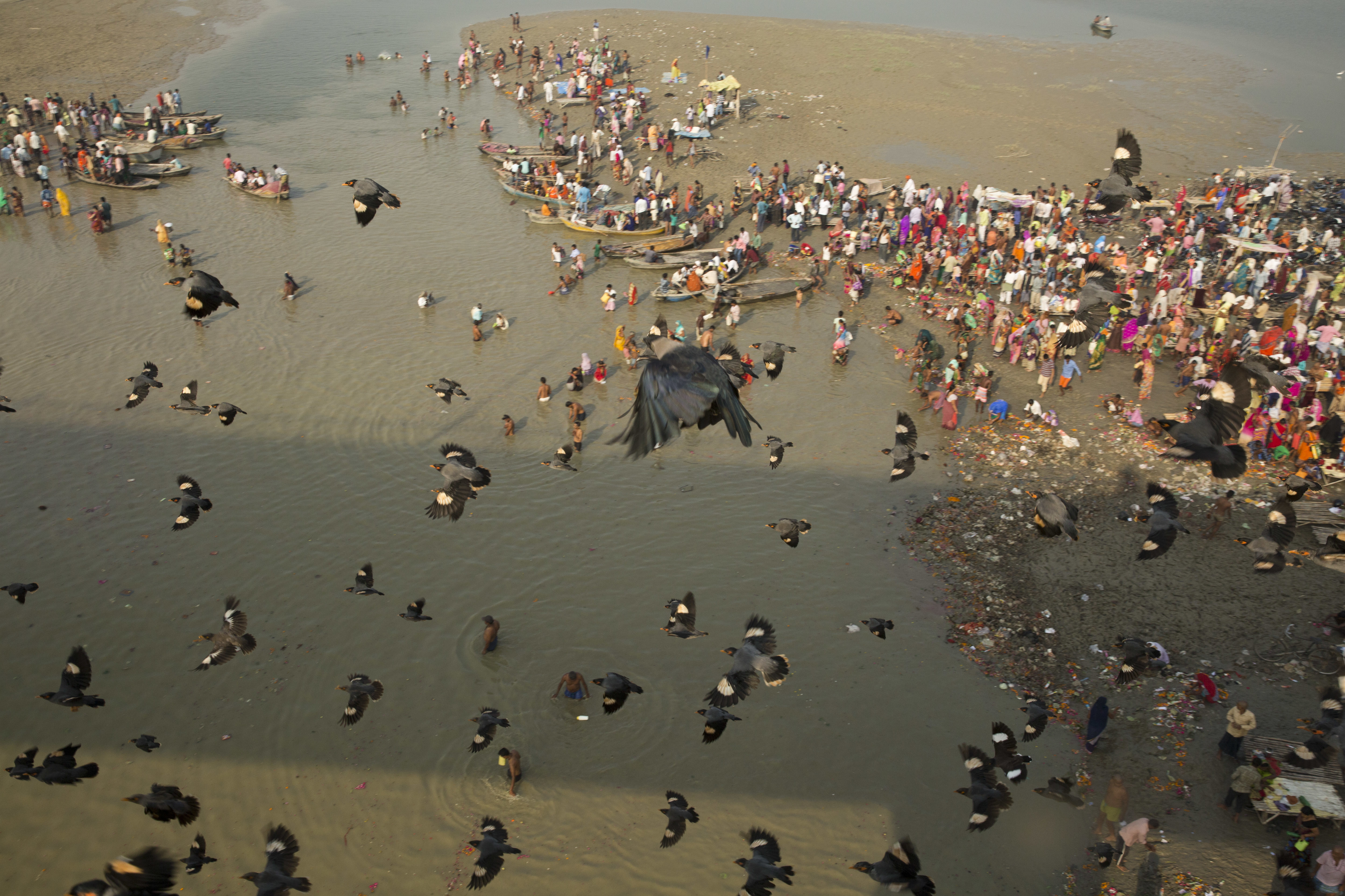Indian Hindu devotees perform morning rituals in the Ganges River on the first day of the nine-day Navratri festival in Allahabad, India - AP