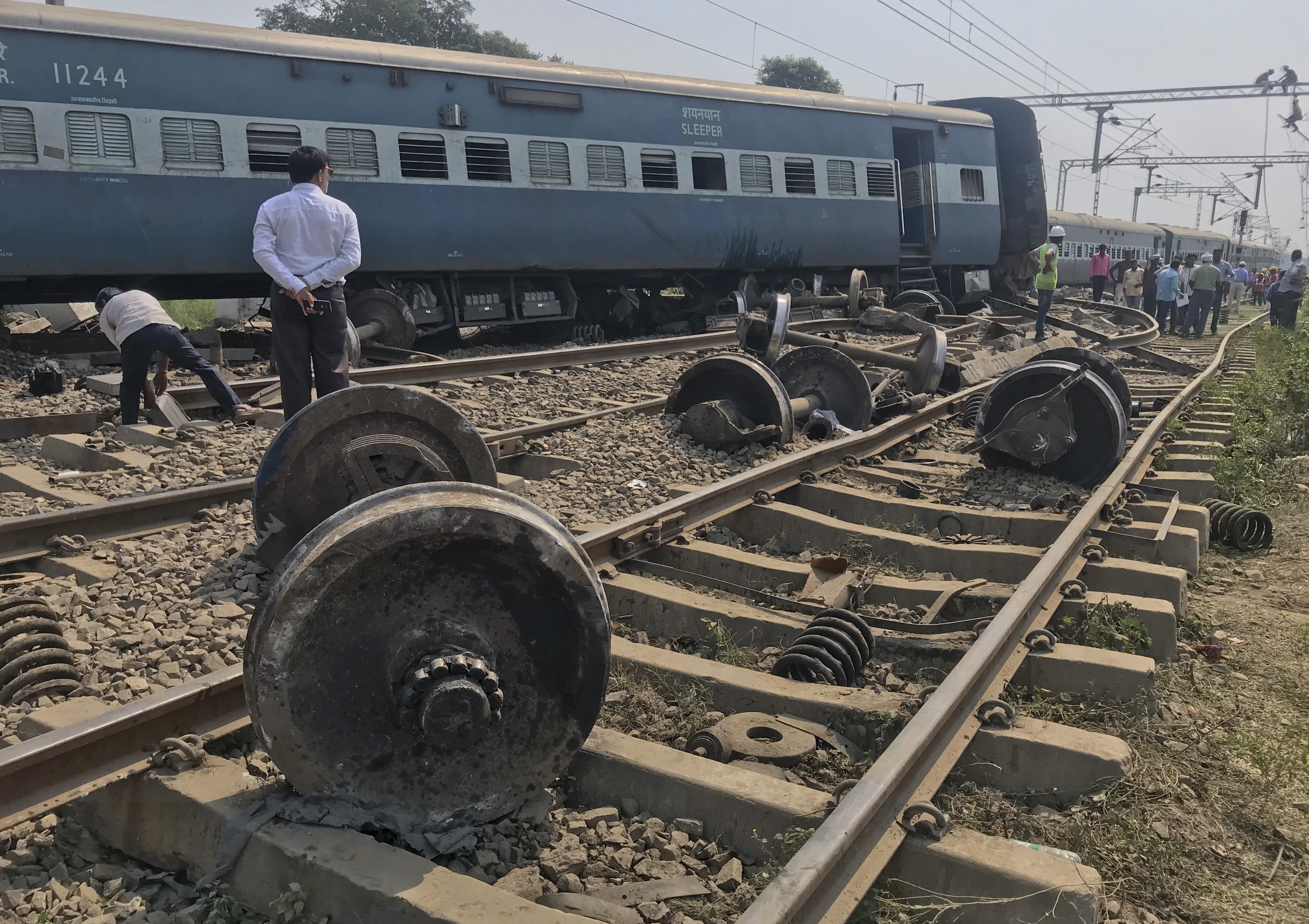 An official stands at the scene after an express train partially derailed at a railway station in Rae Bareli, 80 kilometers southwest of Lucknow, the capital of Uttar Pradesh state, India - PTI