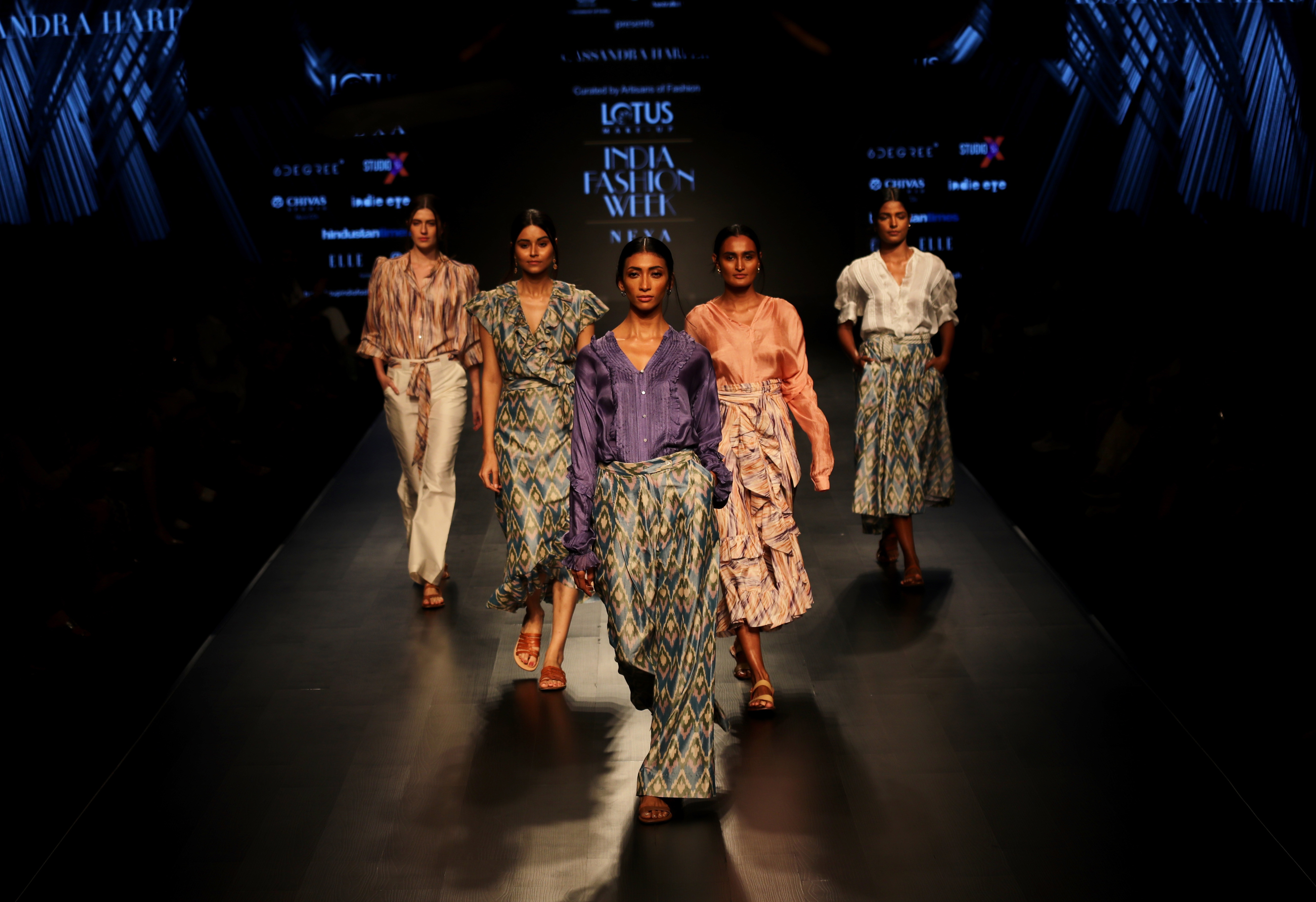 Models walk the ramp during a show curated by the Indian Ministry of Textiles and Australian High Commission at the Lotus Make-up India Fashion Week in New Delhi - AP