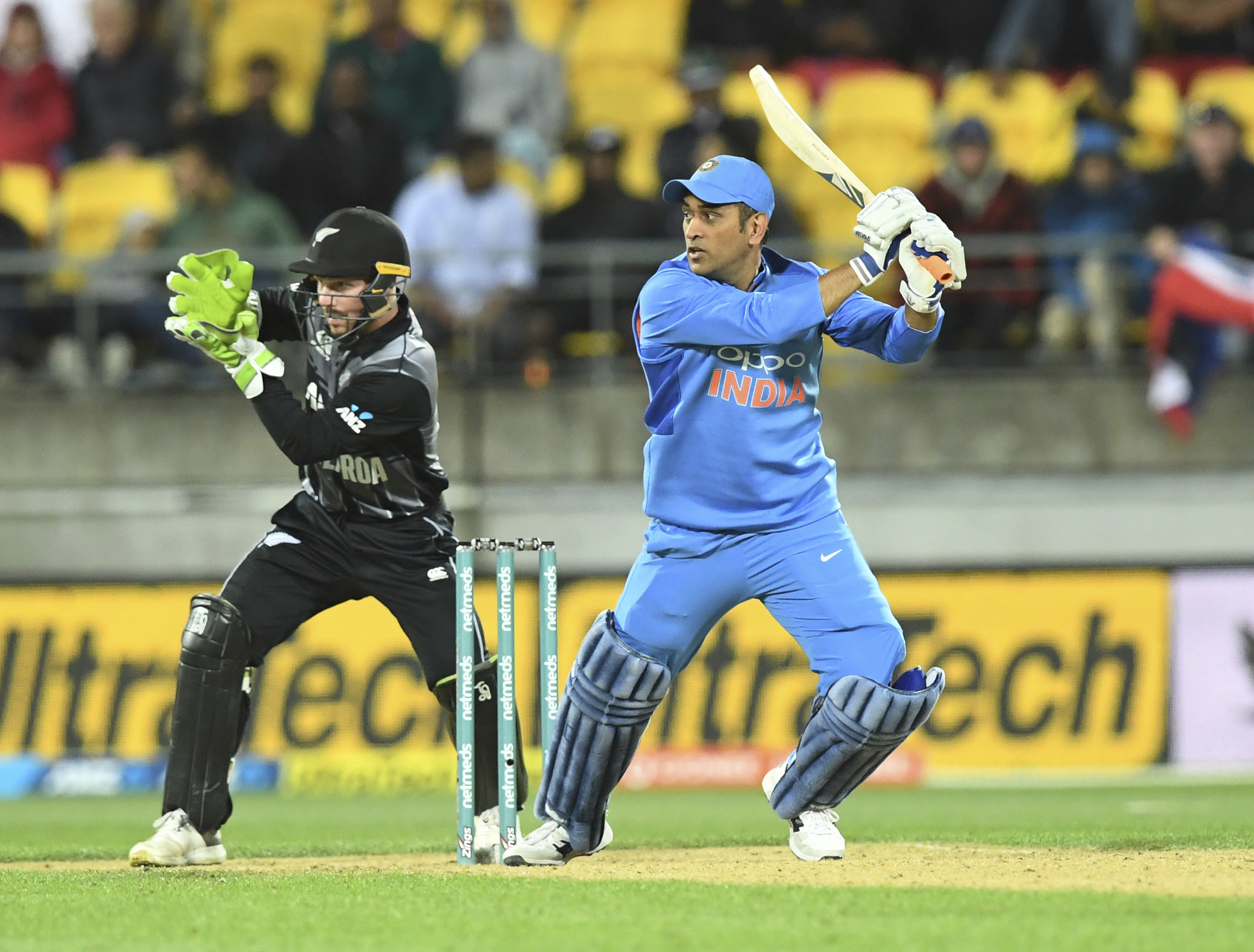 India's MS Dhoni, right, plays in front of New Zealand's Tim Seifert during the twenty/20 cricket international between New Zealand and India in Wellington - AP